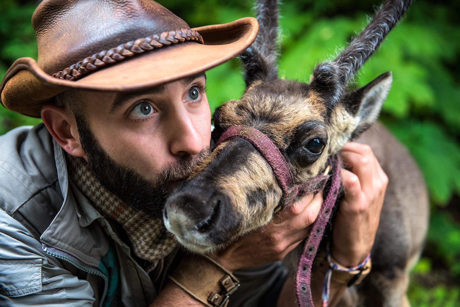 austin-trigg-brave-wilderness-alaska-BW-Coyote-Kiss-Reindeer.jpg