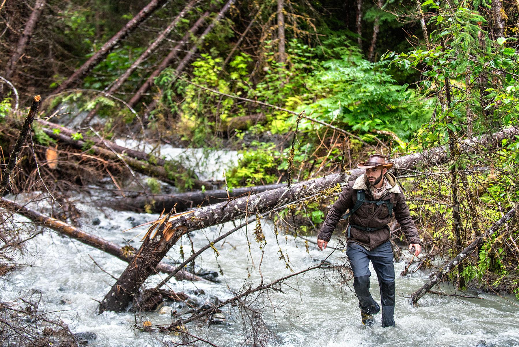 austin-trigg-brave-wilderness-alaska-BW-Coyote-Runs-Through-Stream.jpg