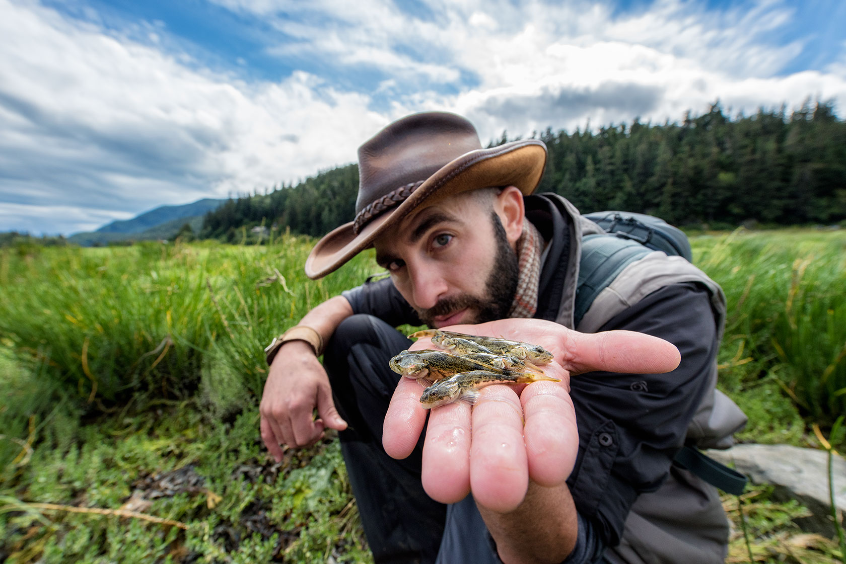 austin-trigg-brave-wilderness-alaska-BW-Coyote-Shows-sculpin-Fish-Mud-Bay.jpg