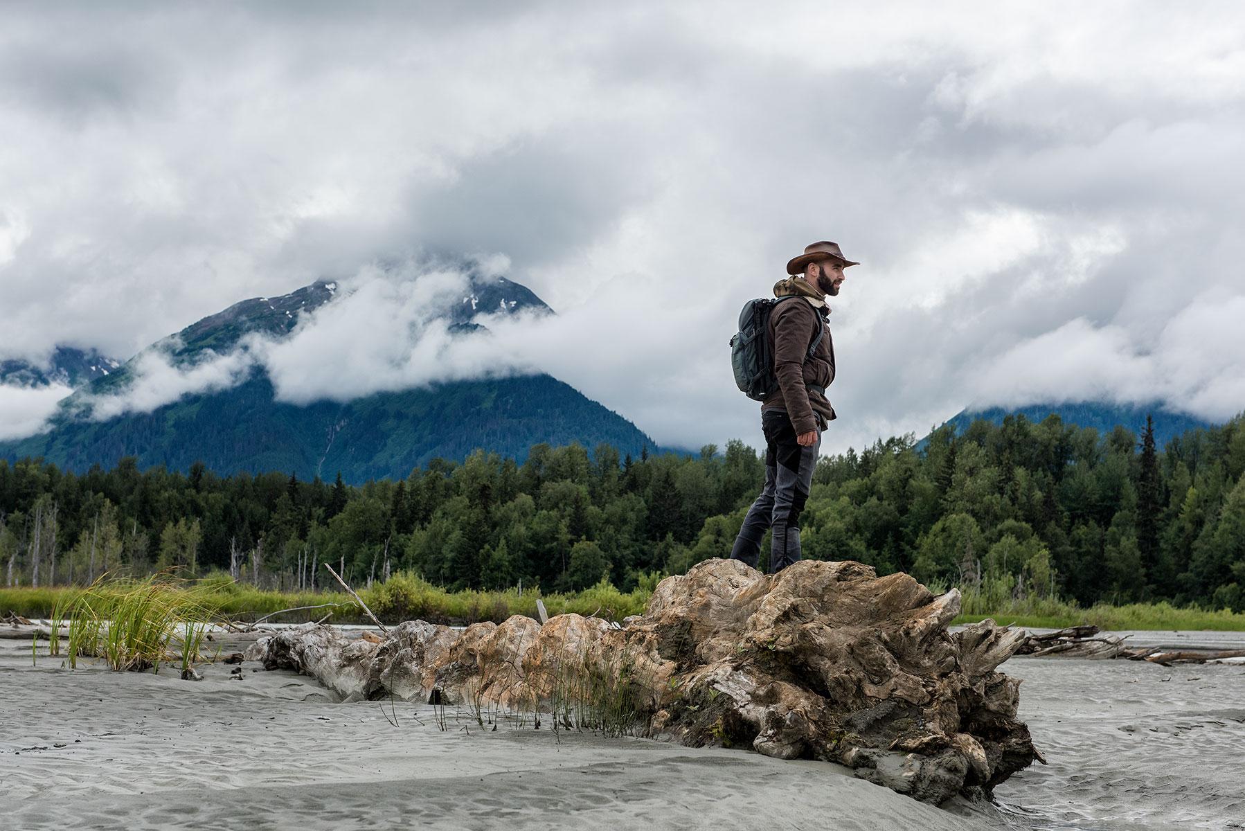 austin-trigg-brave-wilderness-alaska-BW-Coyote-Stands-on-Log.jpg