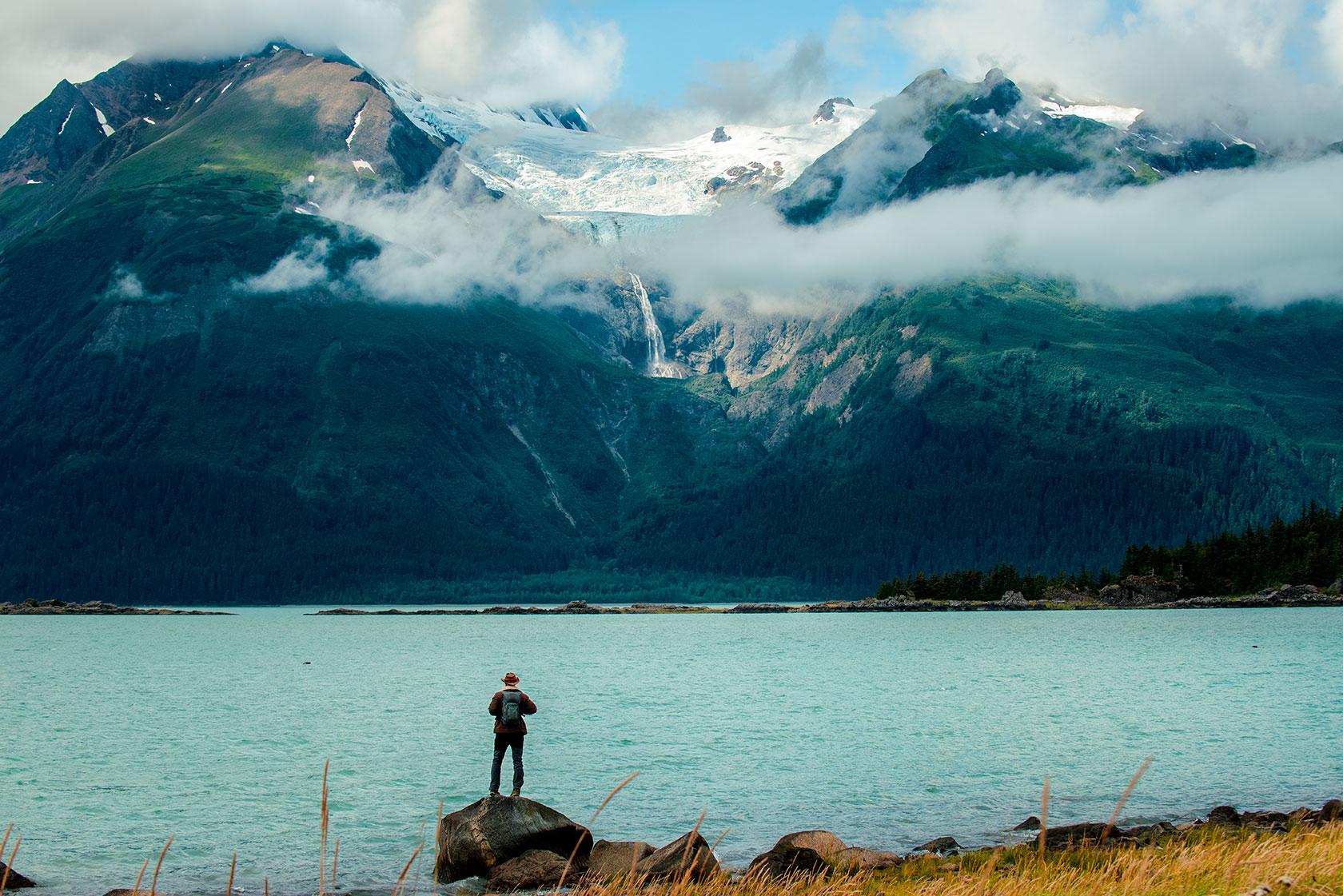 austin-trigg-brave-wilderness-alaska-BW-Coyote-Stares-at-Rainbow-Glacier.jpg