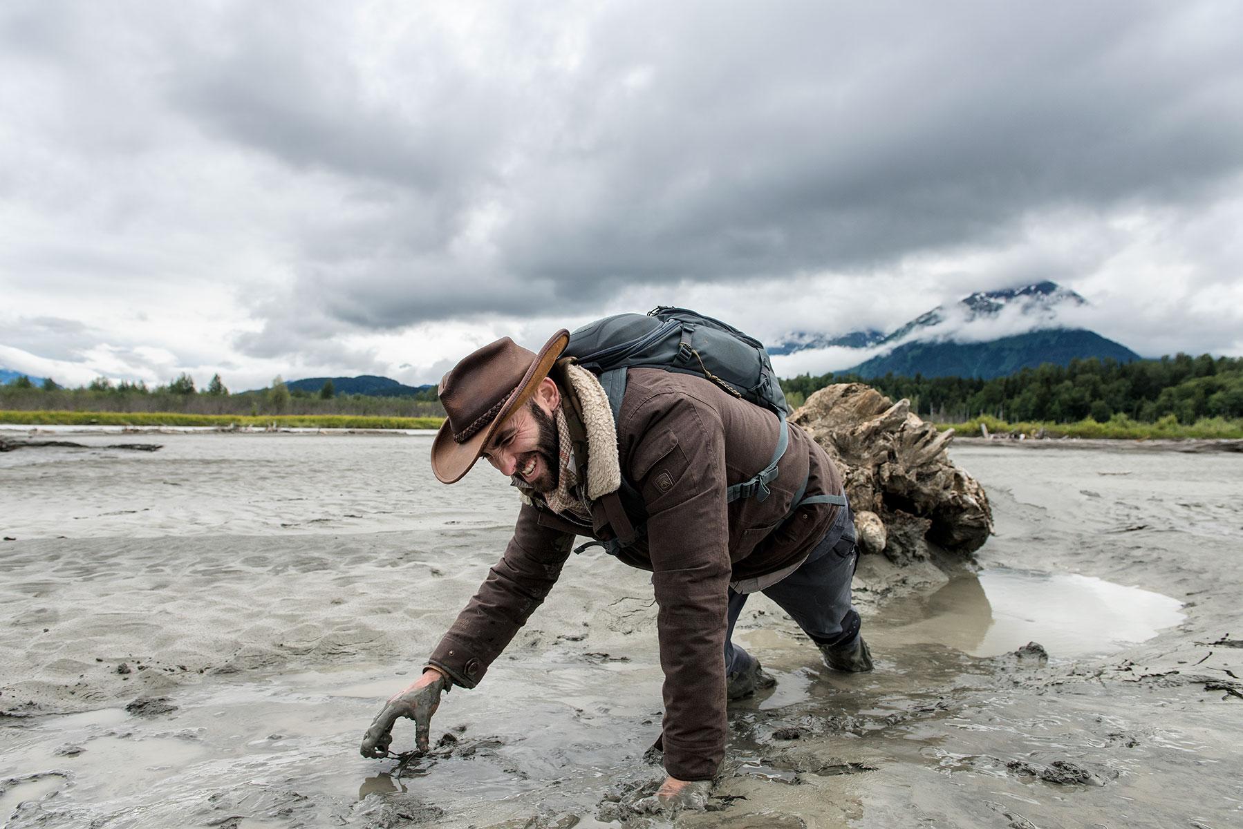 austin-trigg-brave-wilderness-alaska-BW-Coyote-Stuck-in-Mud.jpg
