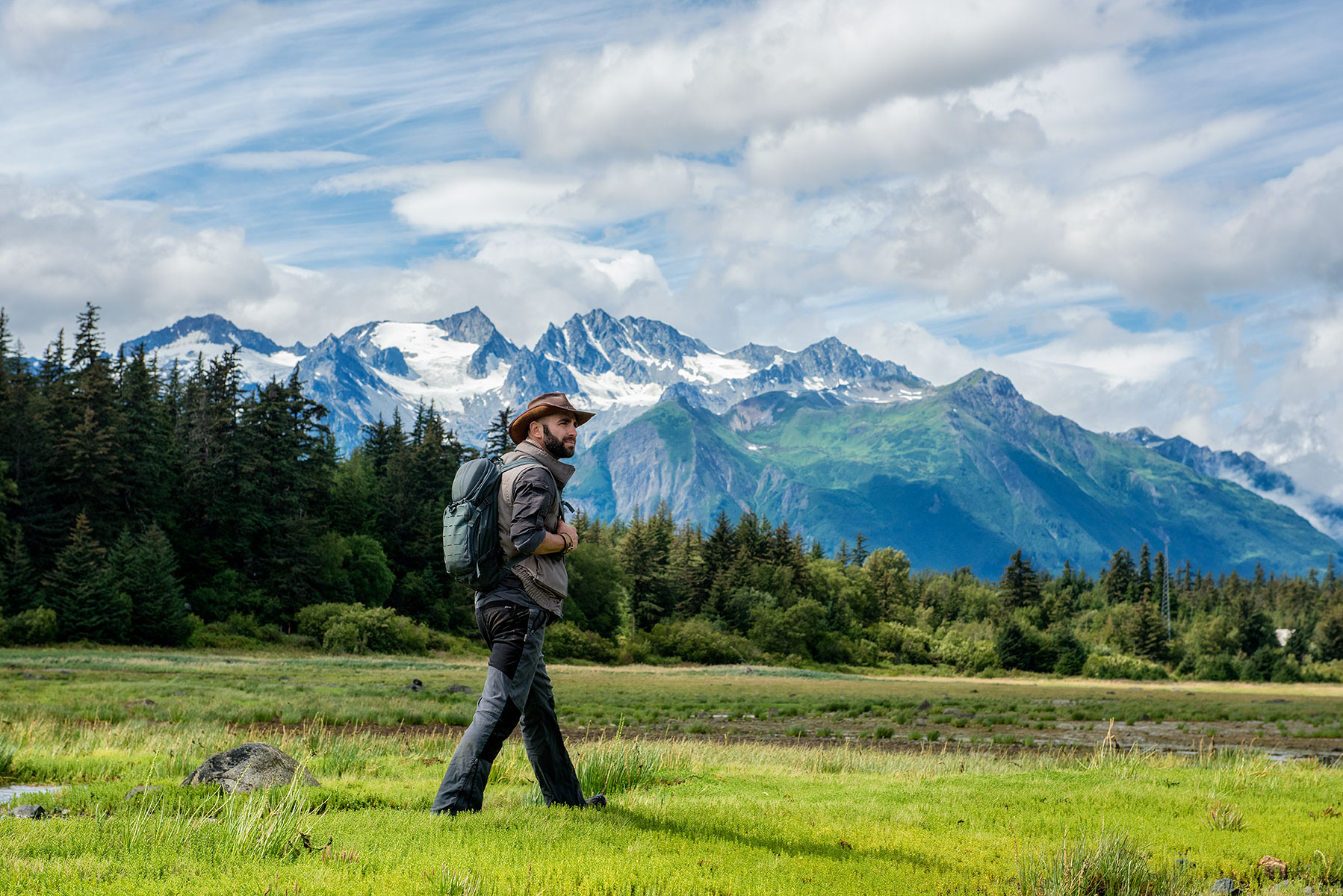 austin-trigg-brave-wilderness-alaska-BW-Coyote-Walks-Mud-Bay-looking-mountains.jpg