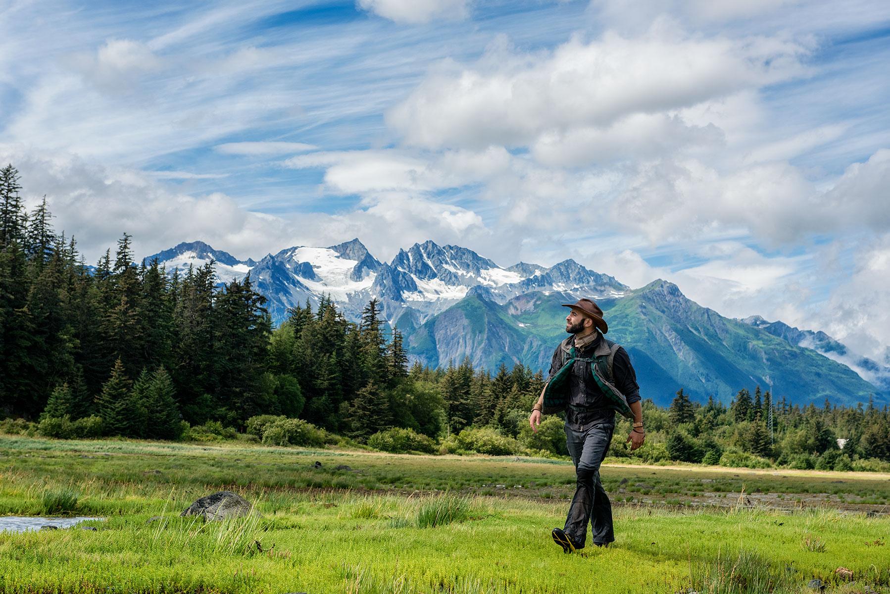 austin-trigg-brave-wilderness-alaska-BW-Coyote-Walks-Mud-Bay-windy-mountains.jpg
