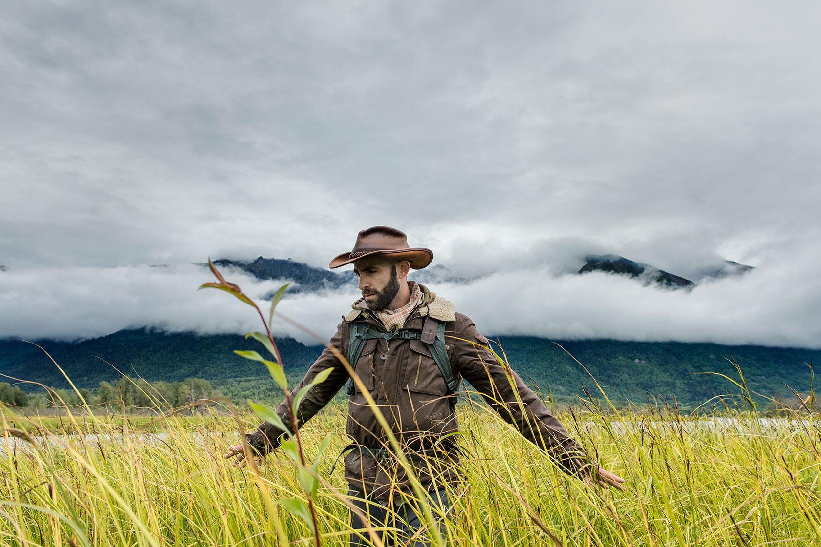 austin-trigg-brave-wilderness-alaska-BW-Coyote-Walks-Through-Weeds.jpg