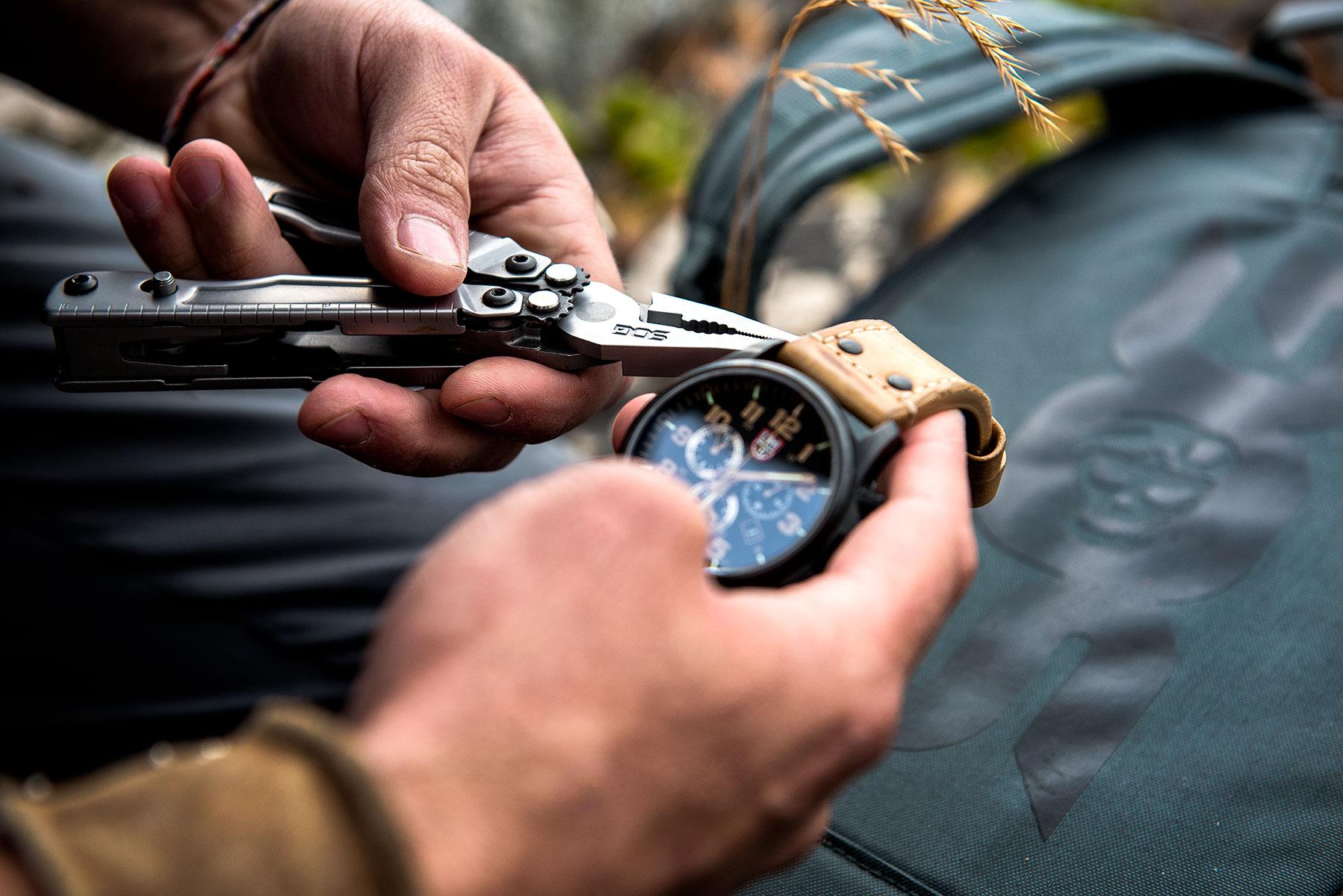 austin-trigg-brave-wilderness-alaska-SOG-Multi-Tool-watch-repair.jpg