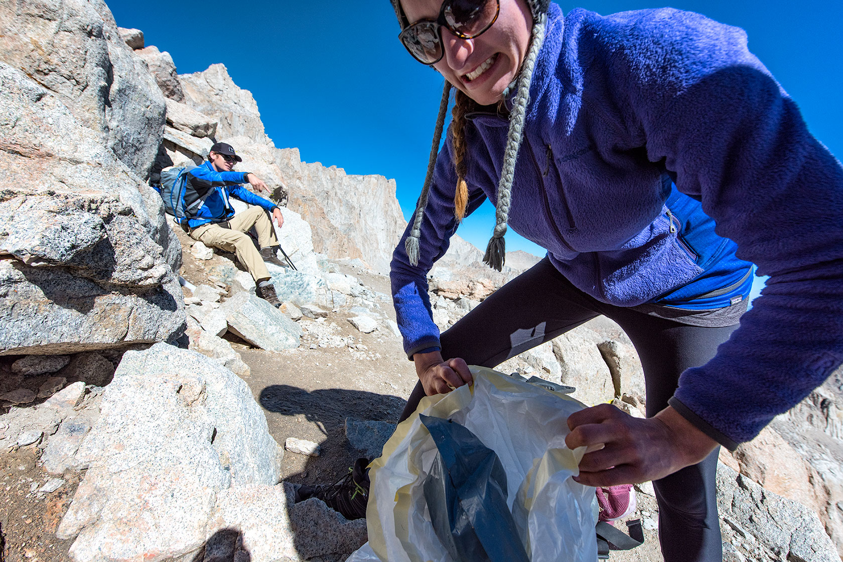 austin-trigg-patagonia-hiking-john-muir-trail-Kerry-Picks-up-Poop-MtWhitney-web.jpg