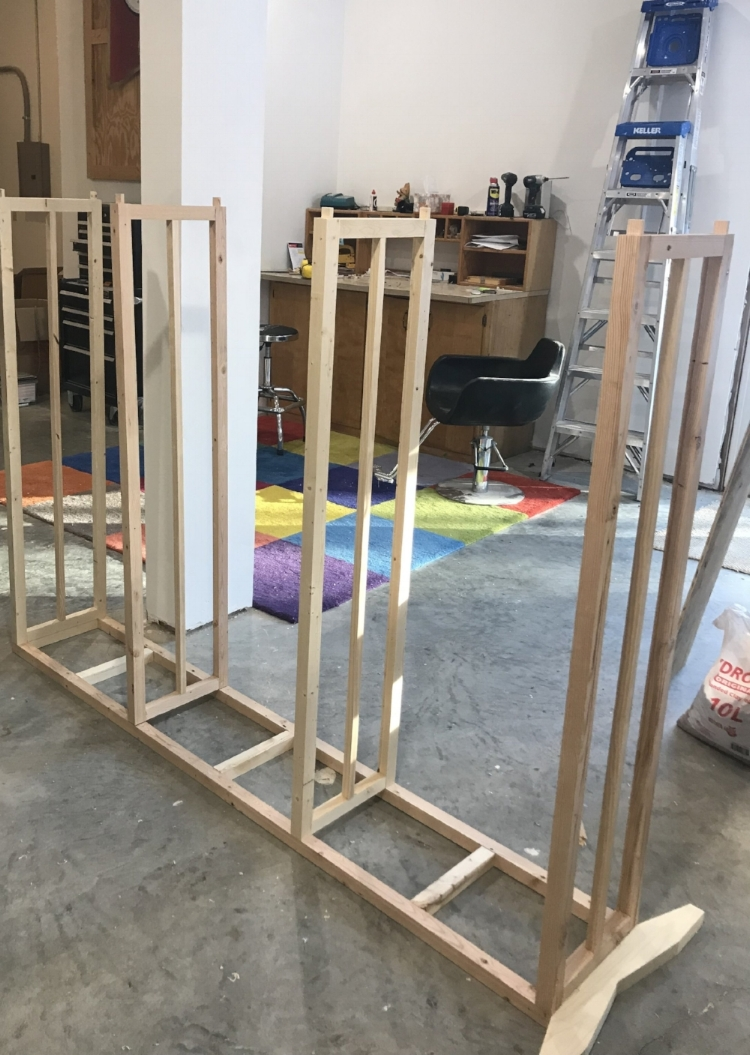 After vertical supports are assembled, lay on floor to square up and attach shelves in equal parts (thirds) relative to total height.