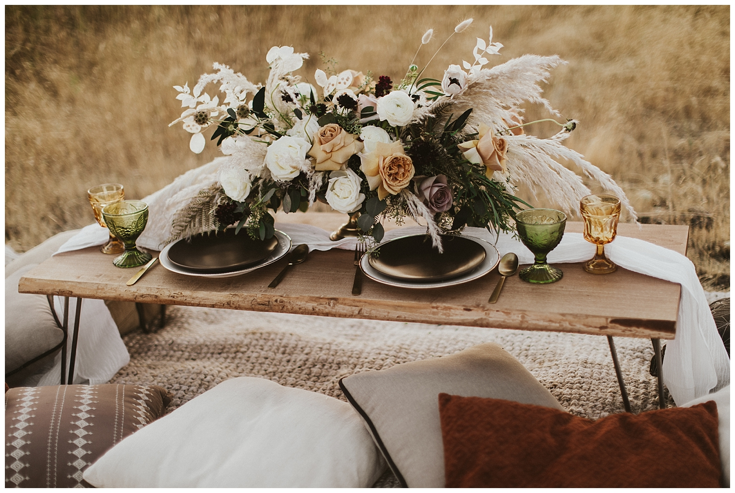 a small table set for two and adorned with a beautiful, dried bouquet