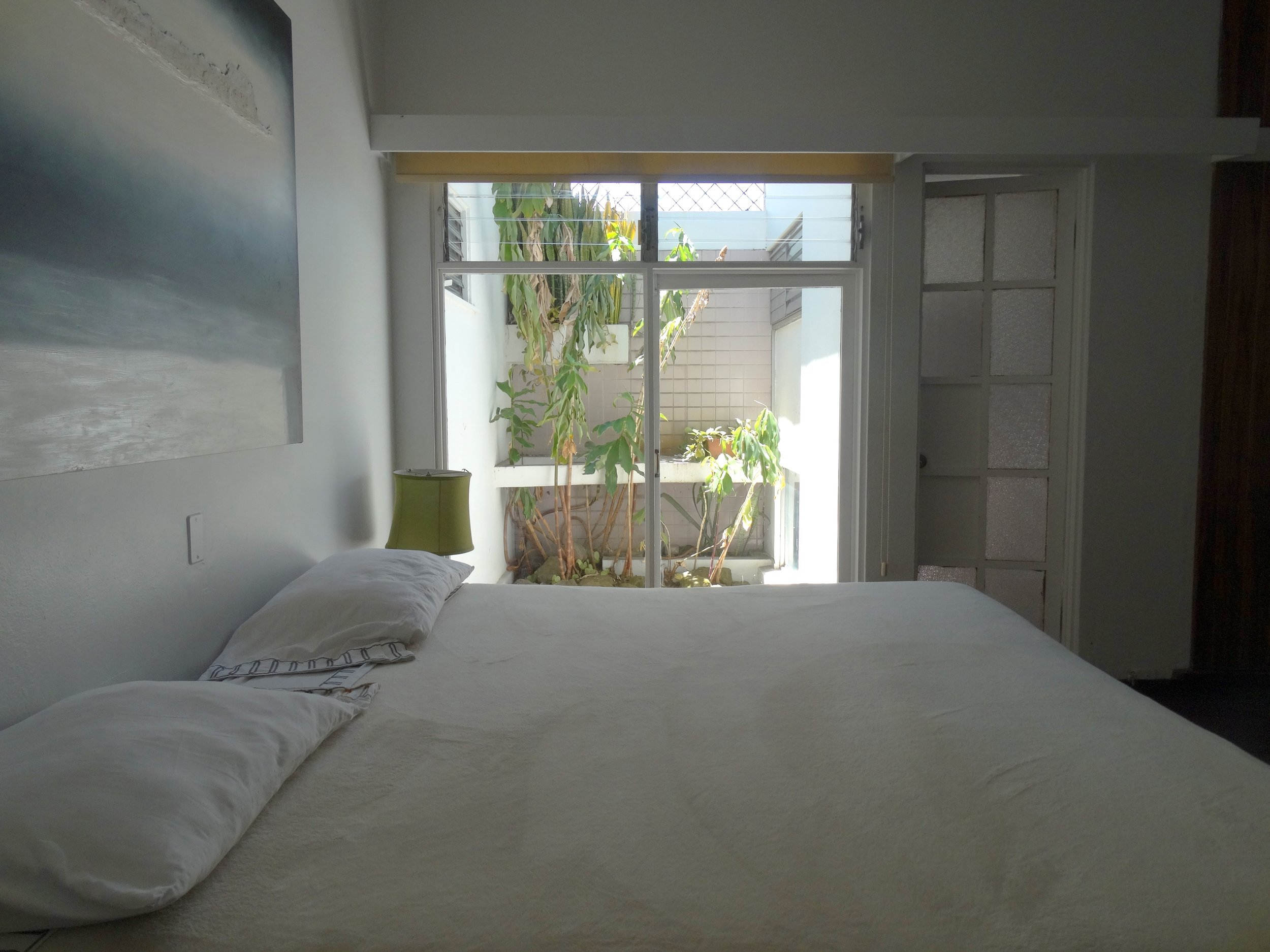 Room with a king size bed and window
