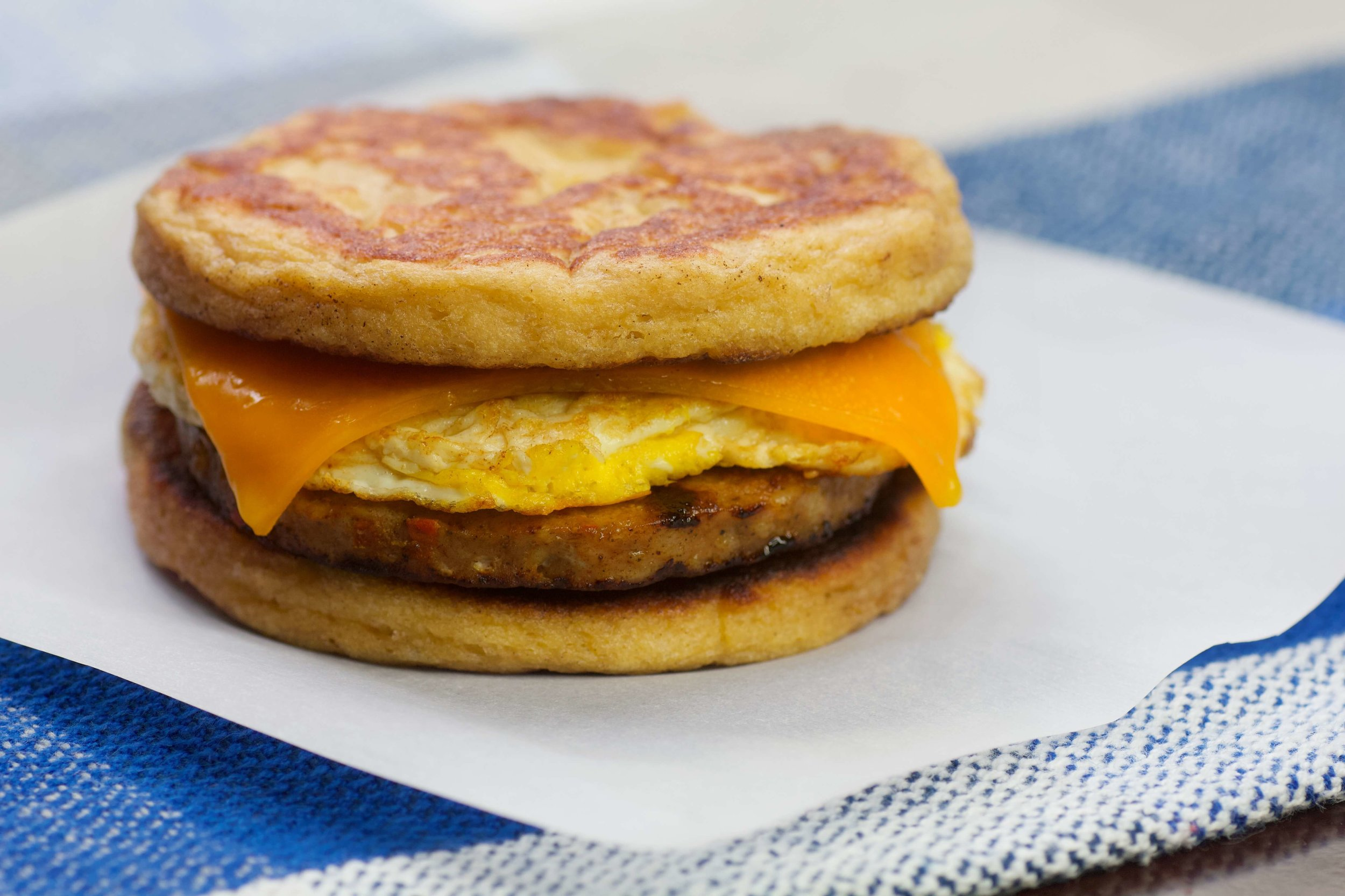 Keto Sausage McGriddles satisfy your fast food breakfast cravings without the fast food crash: a maple-infused patty sandwiches savory sausage, melty cheese, and fresh-cracked egg for the perfect keto-friendly start to your morning.