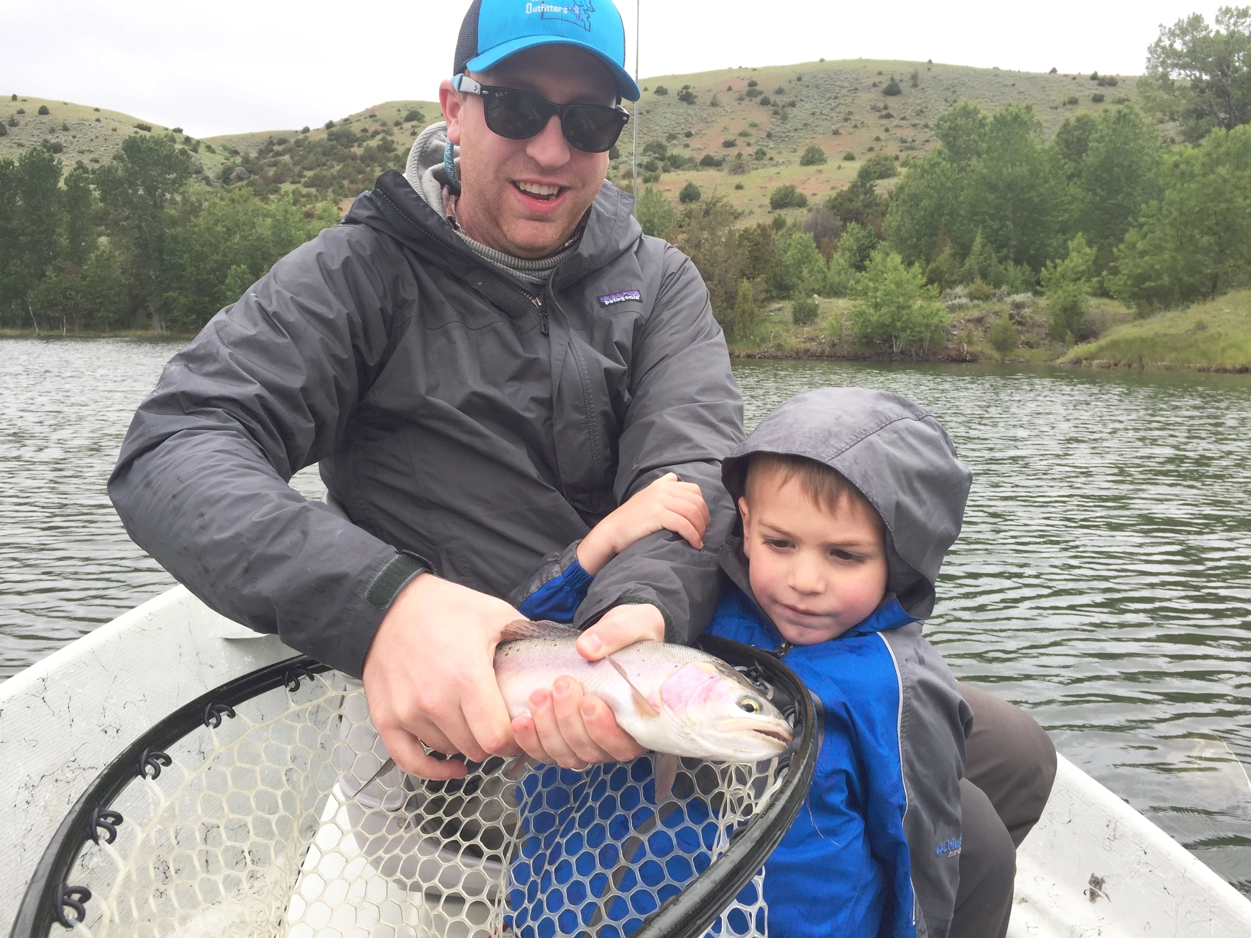 Mr. Finn assisted his dad in landing this Rainbow on Father's day at Story Lake.
