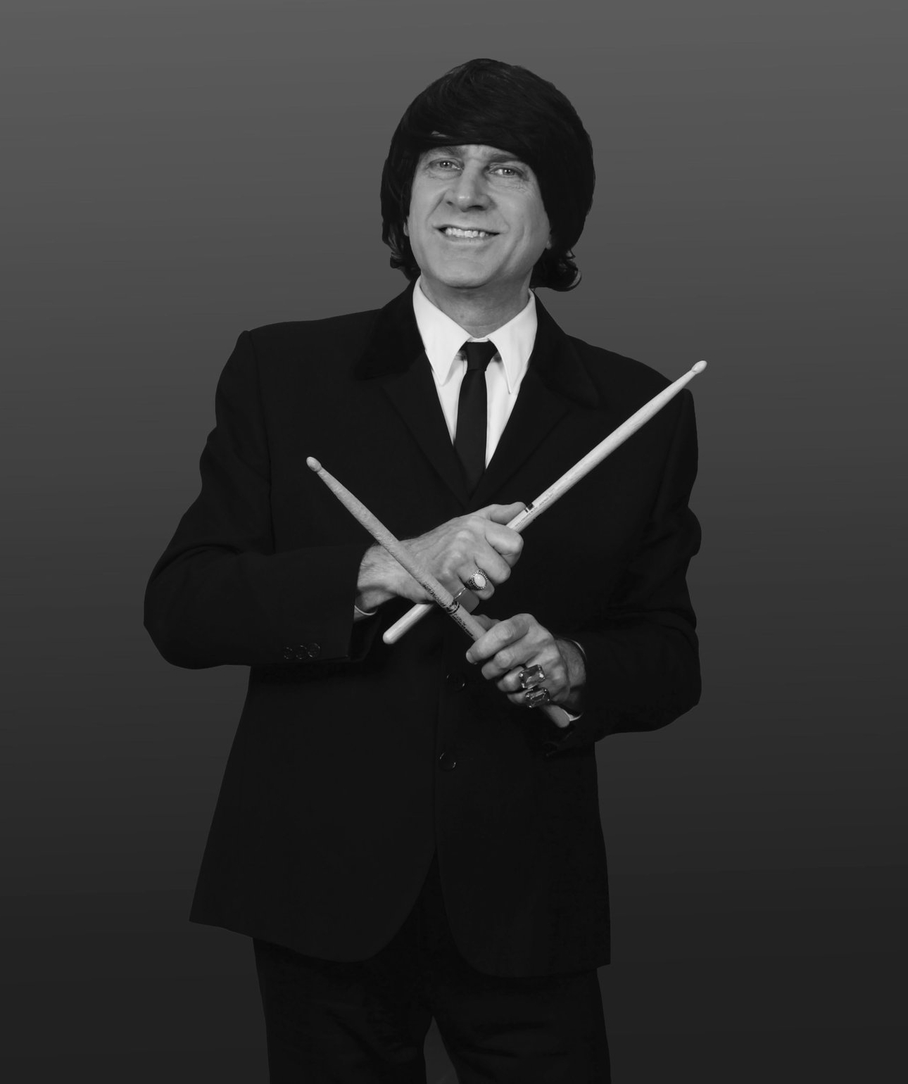 "MIKE SARAFIAN - Ringo Starr, portrayed by Mike Sarafian, is a perfectionist at playing the Ringo drum licks and has always worked hard at his craft and has the same charm as the Beatles drummer. Mike was also a founding member of the Beach Boys tribute band ""Surfin Safari""."