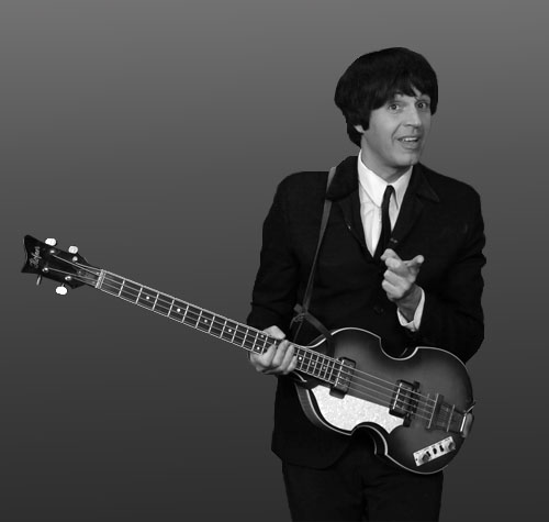 JON PERRY - Paul McCartney, portrayed by Jon Perry, is a naturally left handed guitarist. He has the vocal range and the personality of Paul and his stage presence leaves everyone thinking they have seen Sir Paul in action.He has had a solo McCartney tribute show,and has toured with RCCL Cruise Liners, and has worked with cast members of Beatlemania.