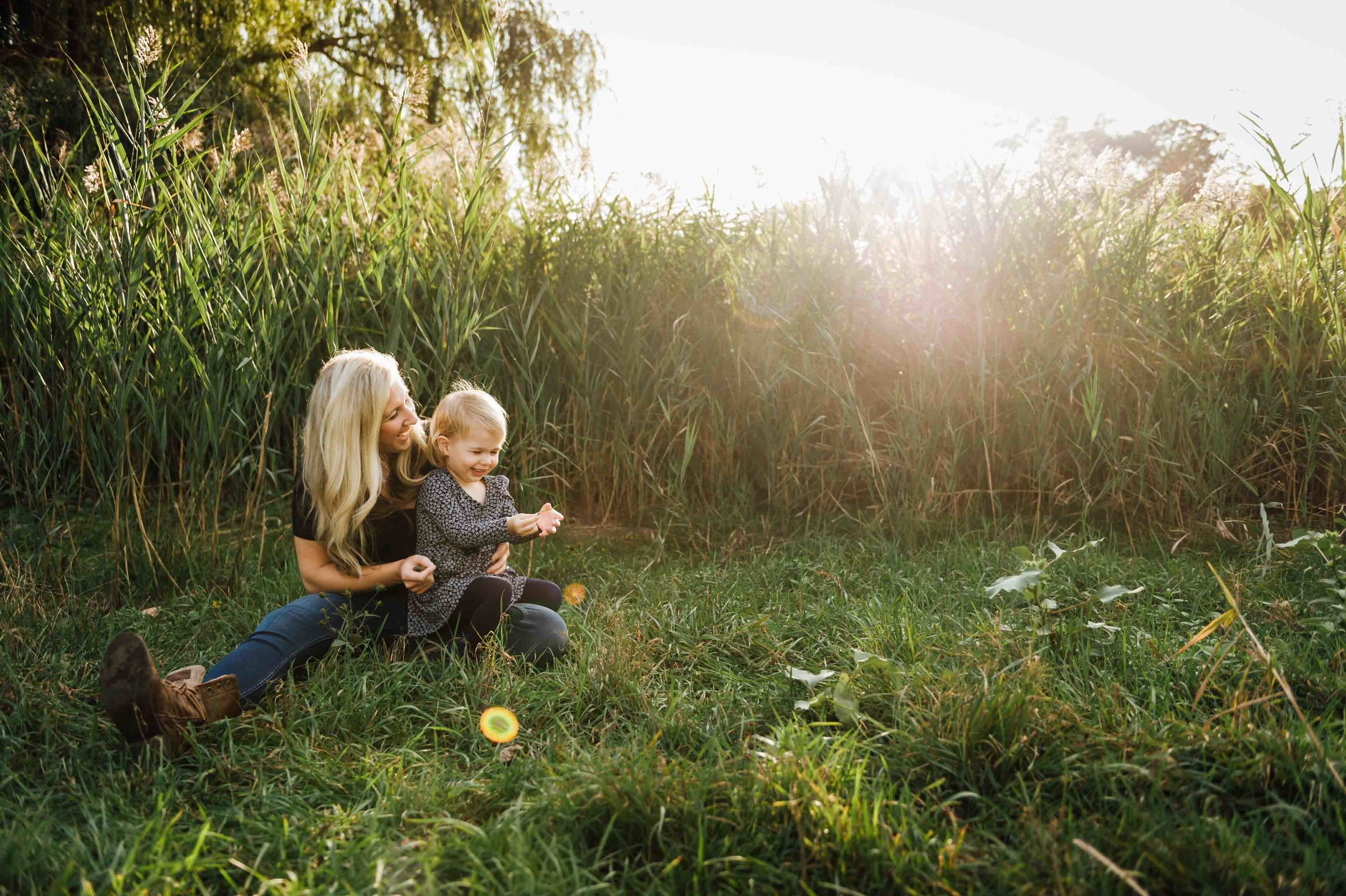mom with little girl in field at sunset - niagara family photographer