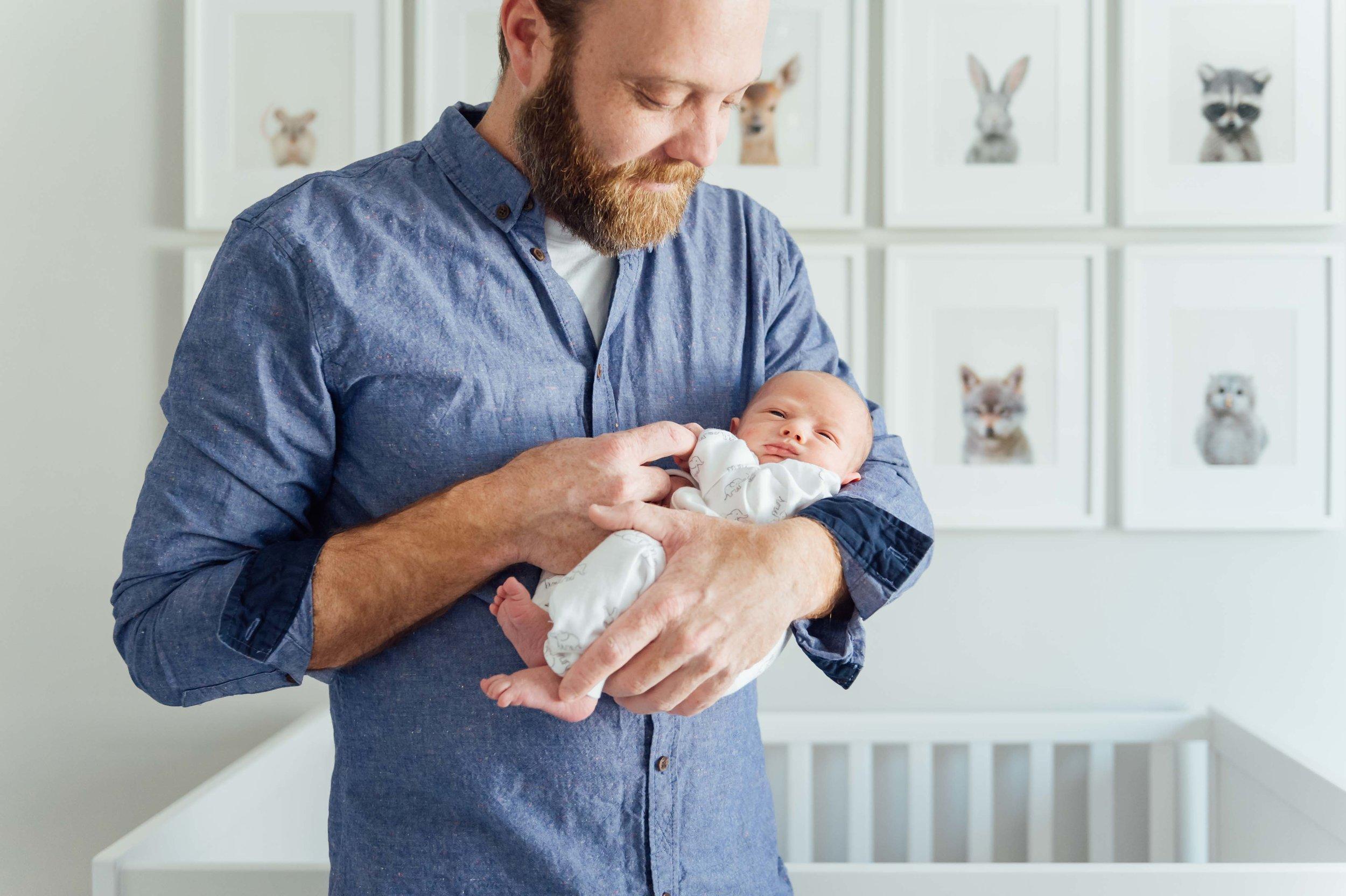 newborn in new fathers arms - niagara newborn photography
