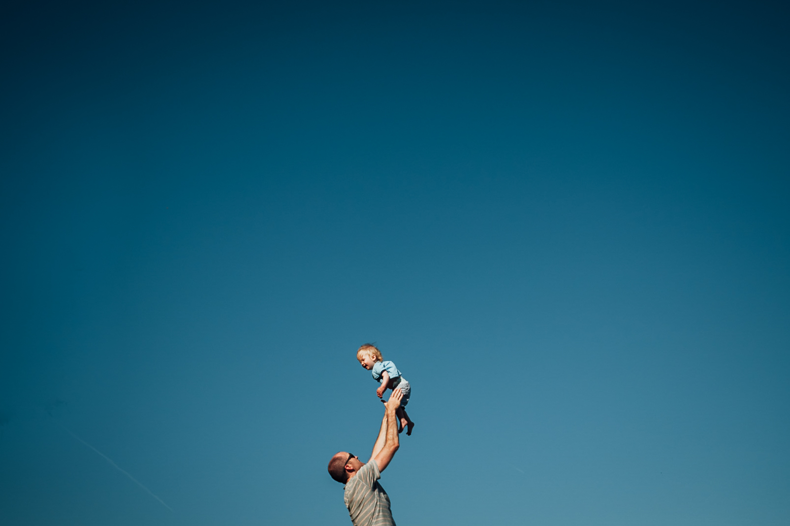 dad and son playing outside - niagara family photographer