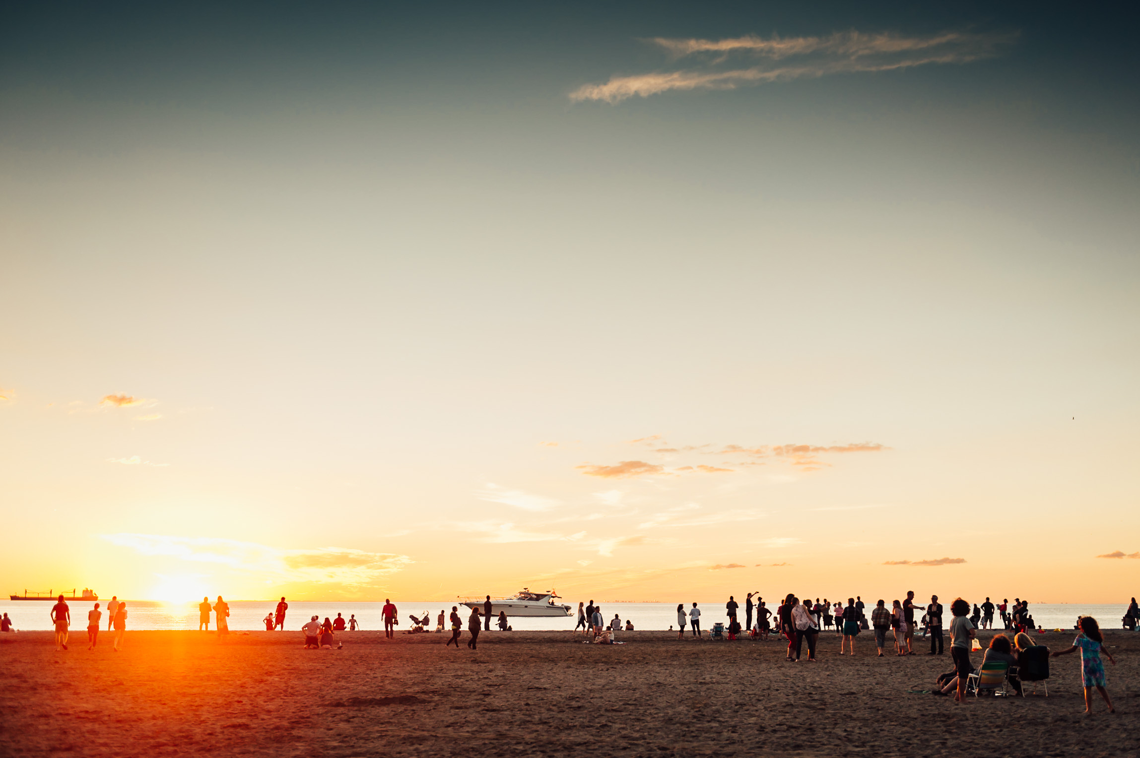 people playing st Sunset beach - St Catharines family photographer