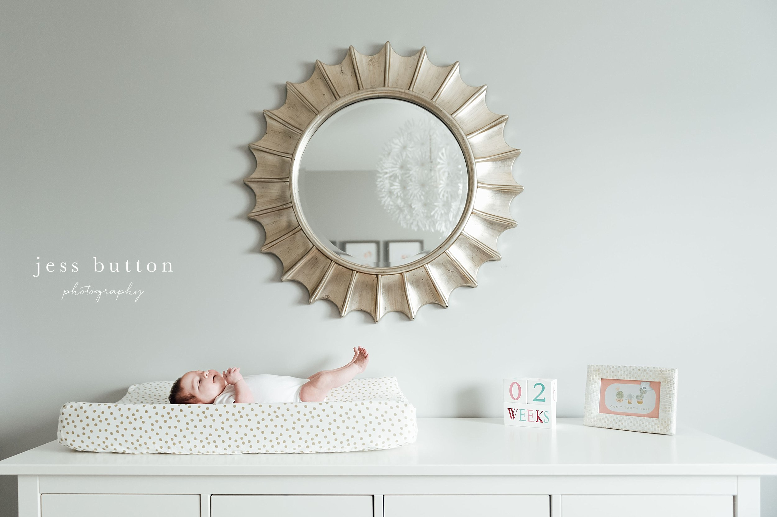 2 week old baby girl on change pad - Fonthill - Niagara Newborn Photography