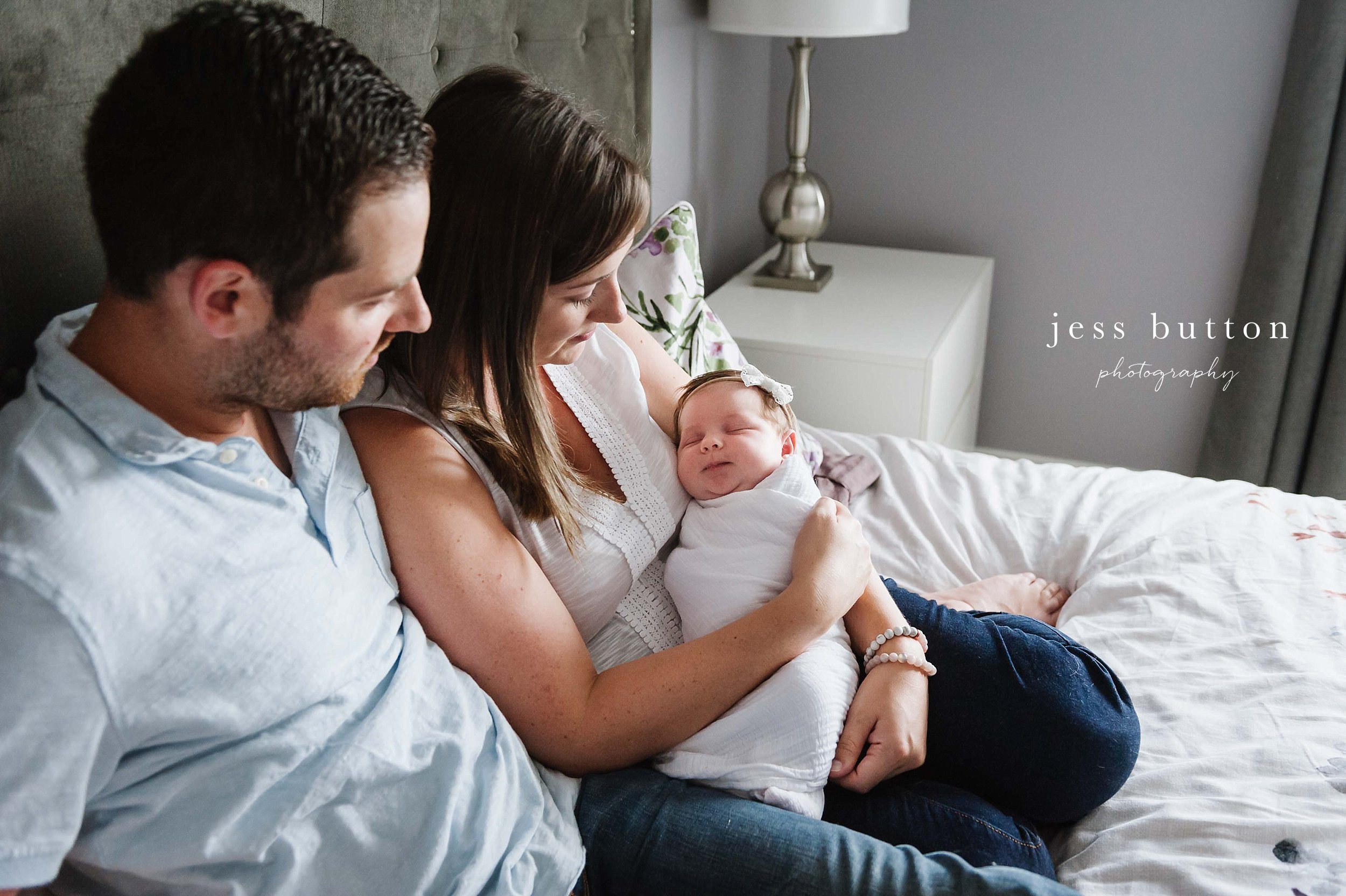 8 day old girl in mother's arms at home - Fonthill - Niagara Newborn Photography