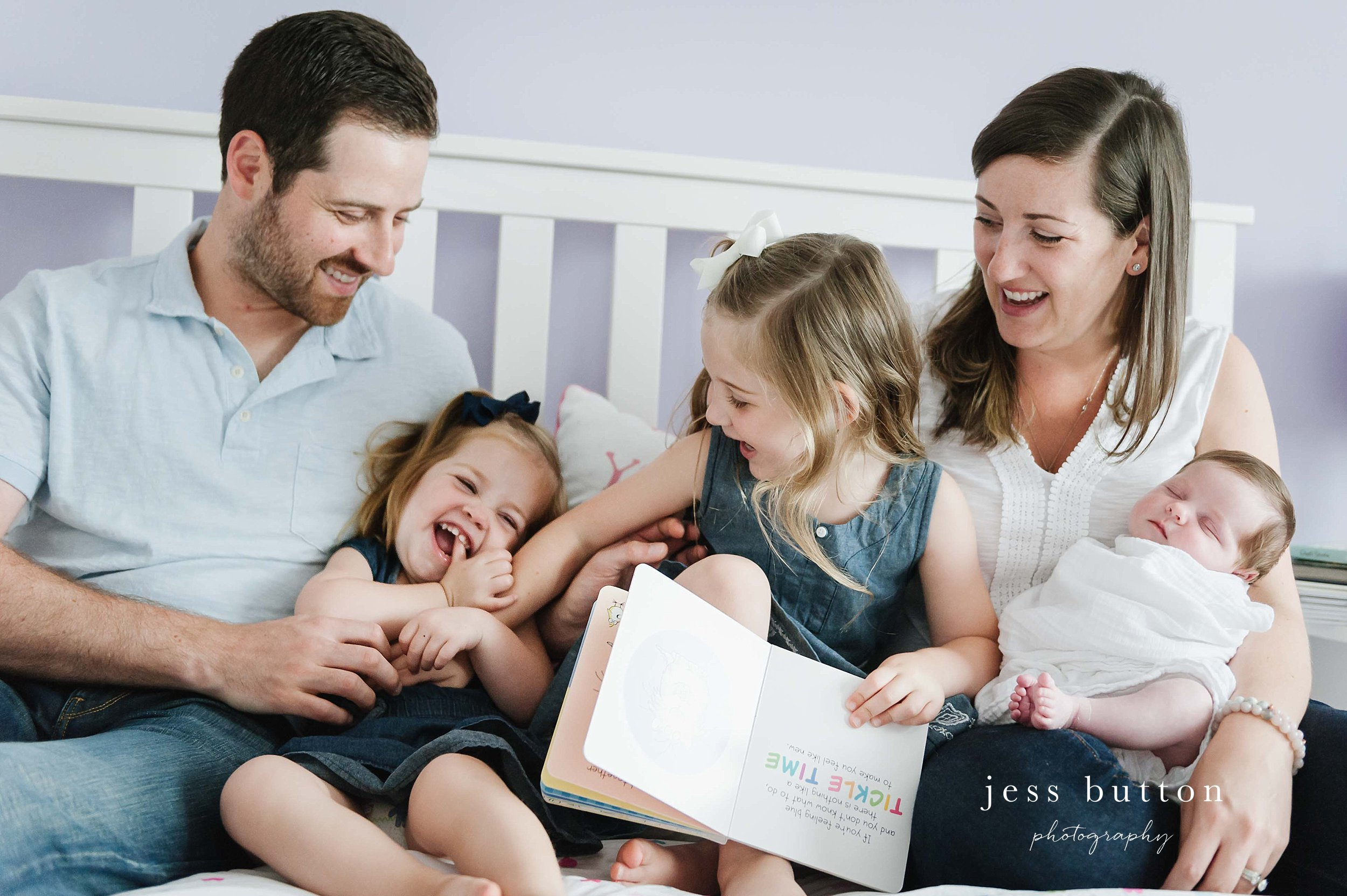family tickling in bed - Fonthill - Niagara Newborn Photography