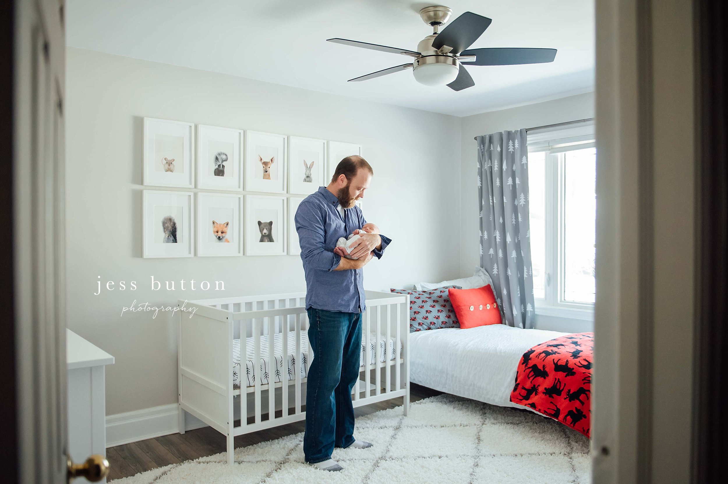 grey nursery with animal prints - new dad with baby - lifestyle photographer