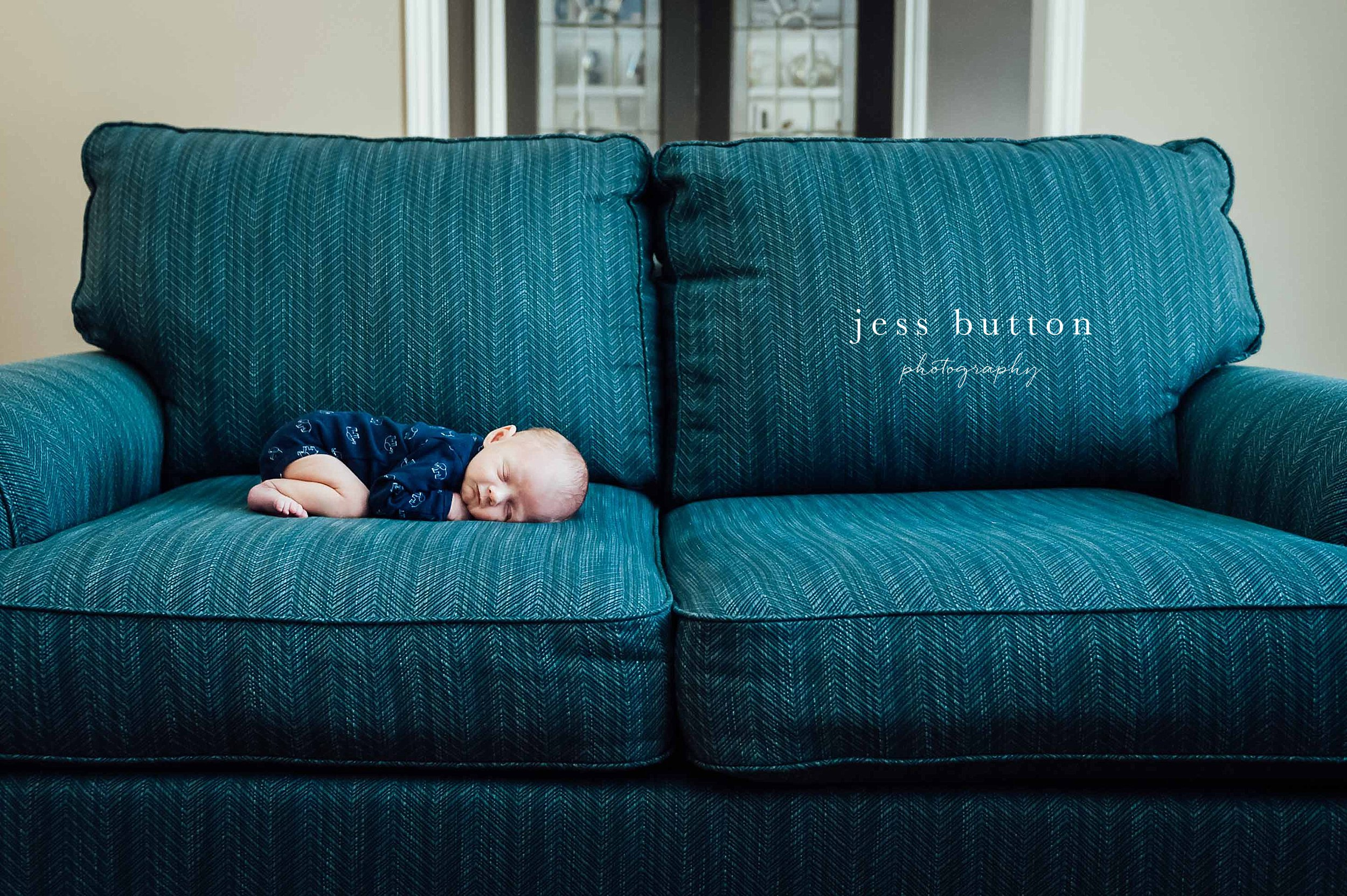 newborn sleeping on couch - Niagara in-home newborn photographer