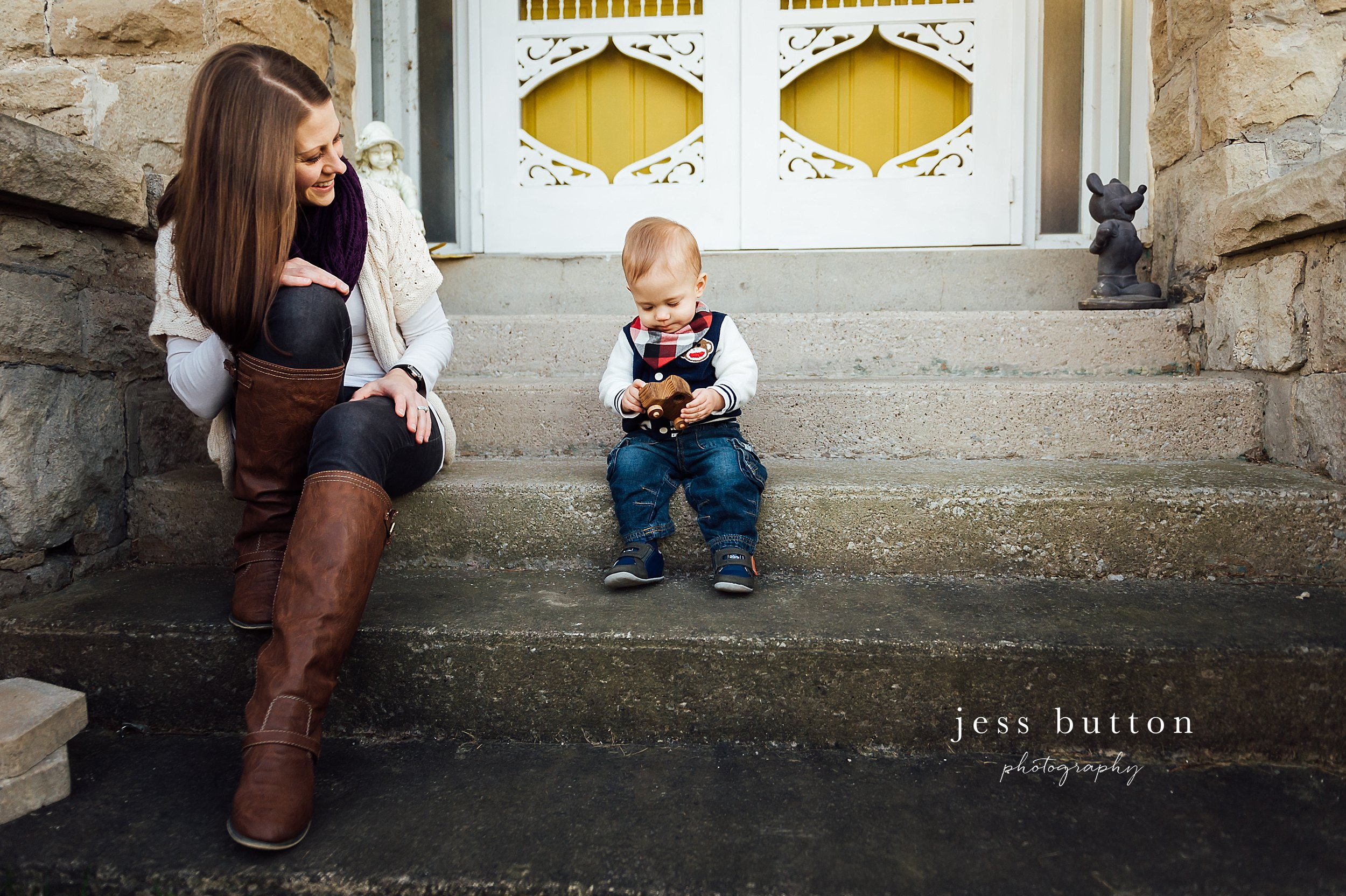 Niagara Family Photographer - photos at home in St Catharines - 10 month old baby bot on front porch in front of yellow door