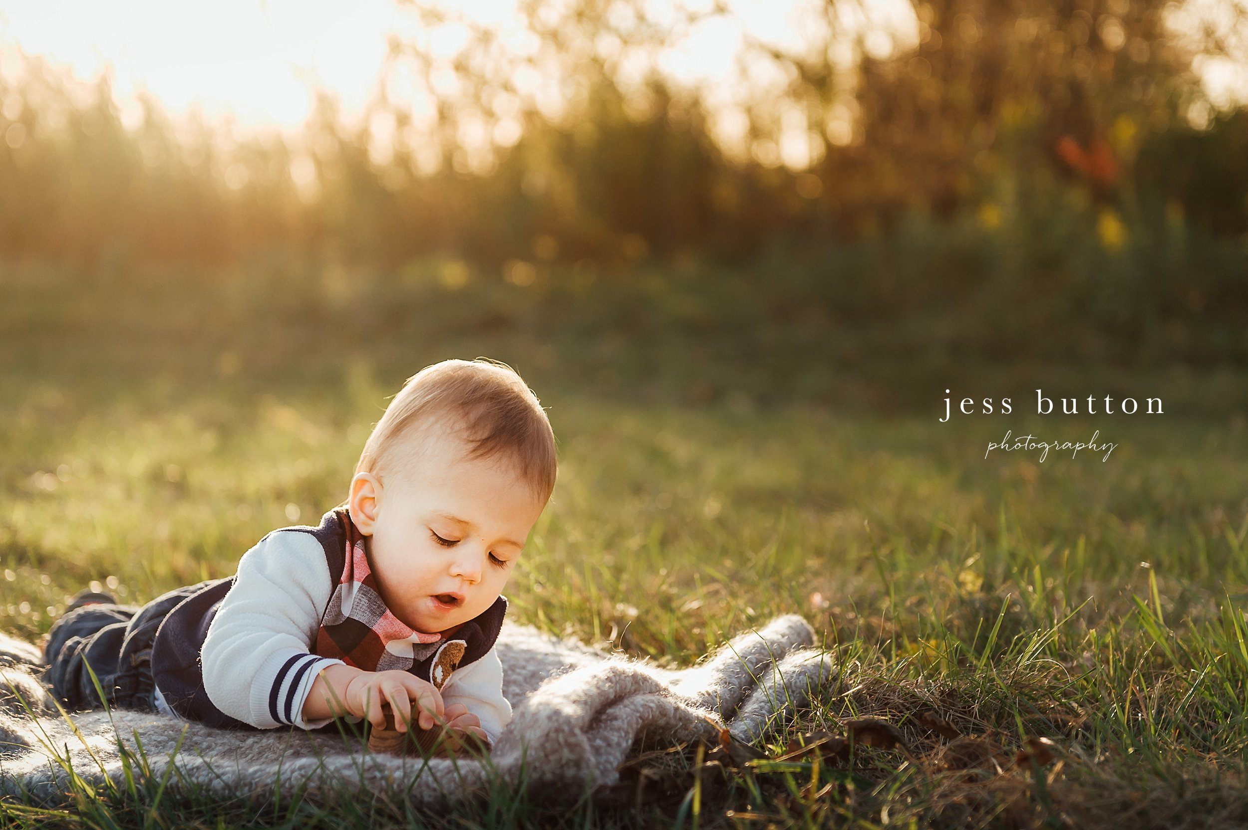 Niagara Family Photographer - photos at home in St Catharines - 10 month old baby boy in field