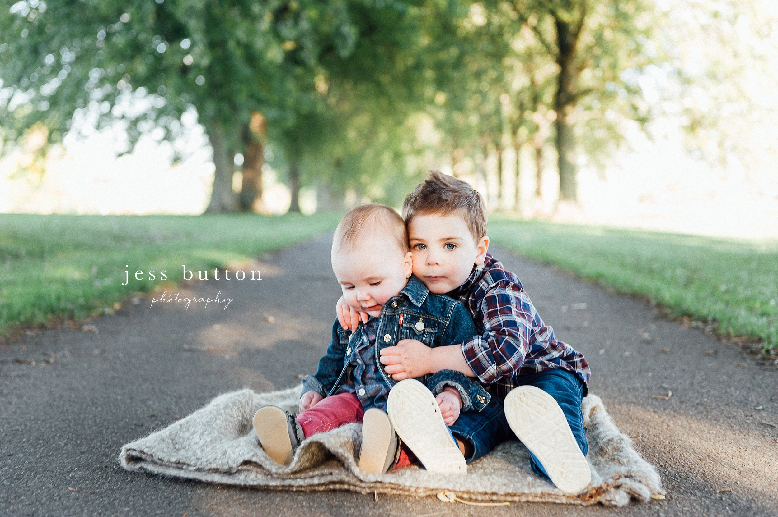 Niagara Family Photographer - Fall family portraits Niagara-on-the-Lake - brother and sister sitting together on path
