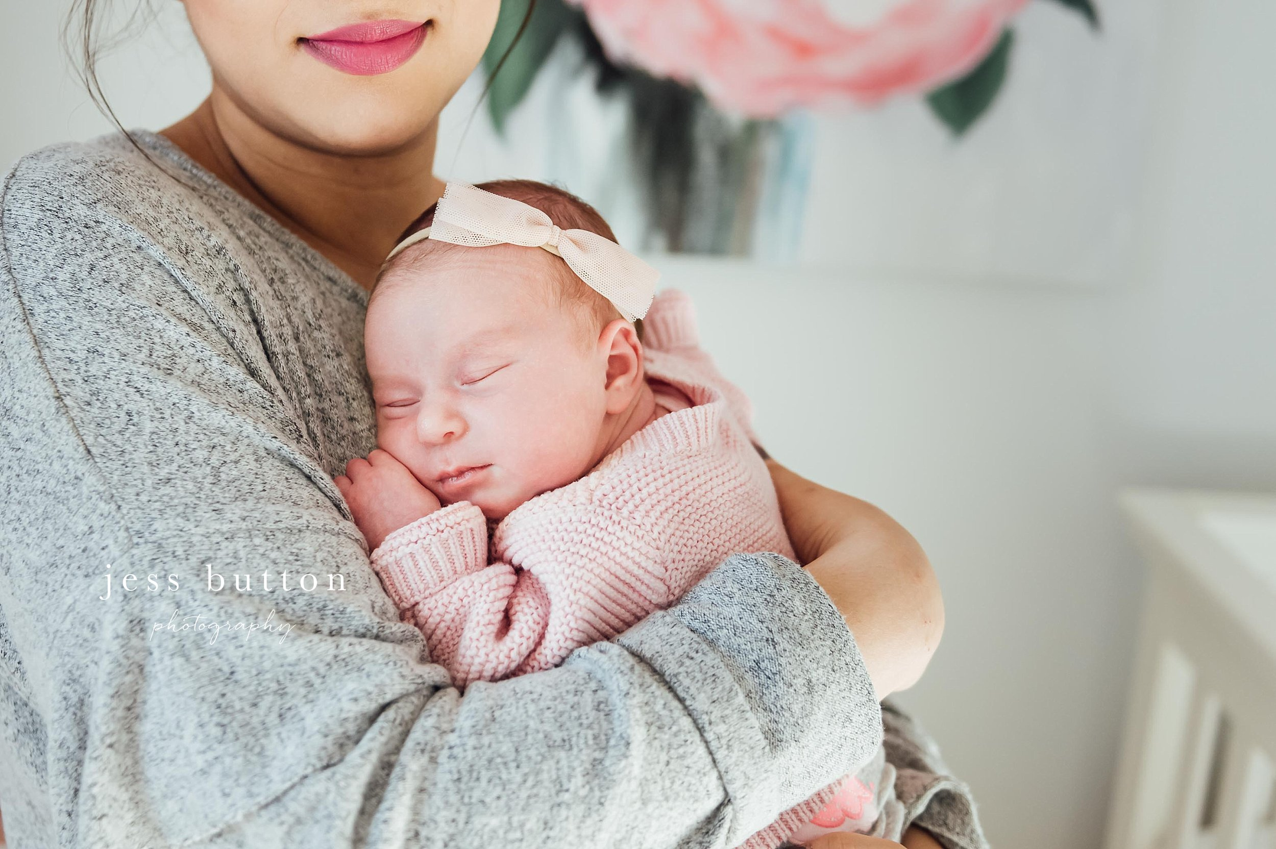 Niagara Newborn Photographer - baby girl in mothers arms