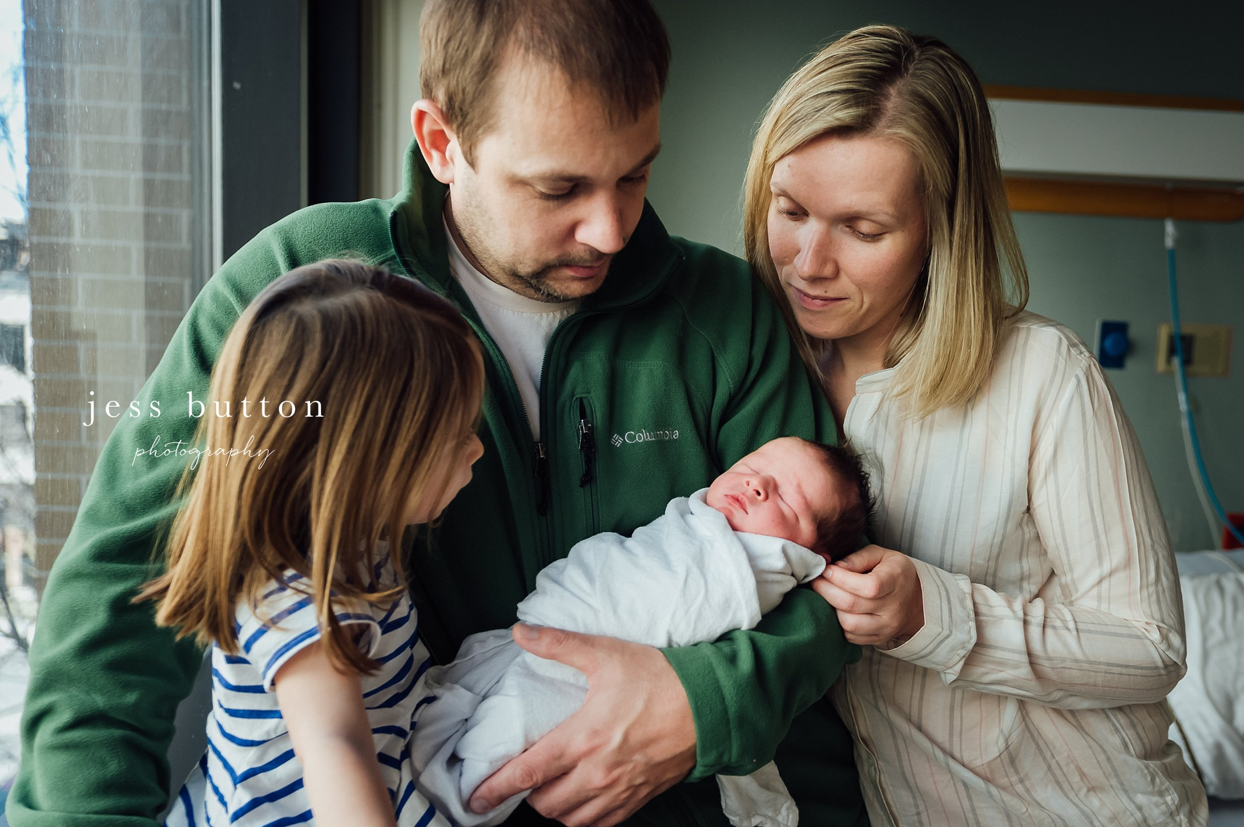 family of 4 during newborn fresh 48 photos session
