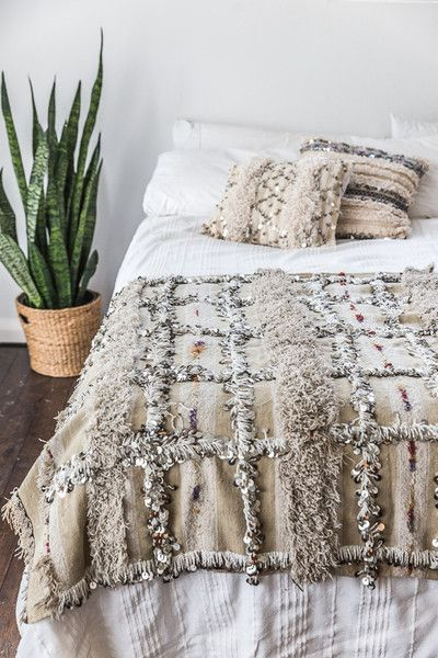 This authentic Moroccan Wedding Blanket and cushions really makes this simplistic, miniaml bedroom.