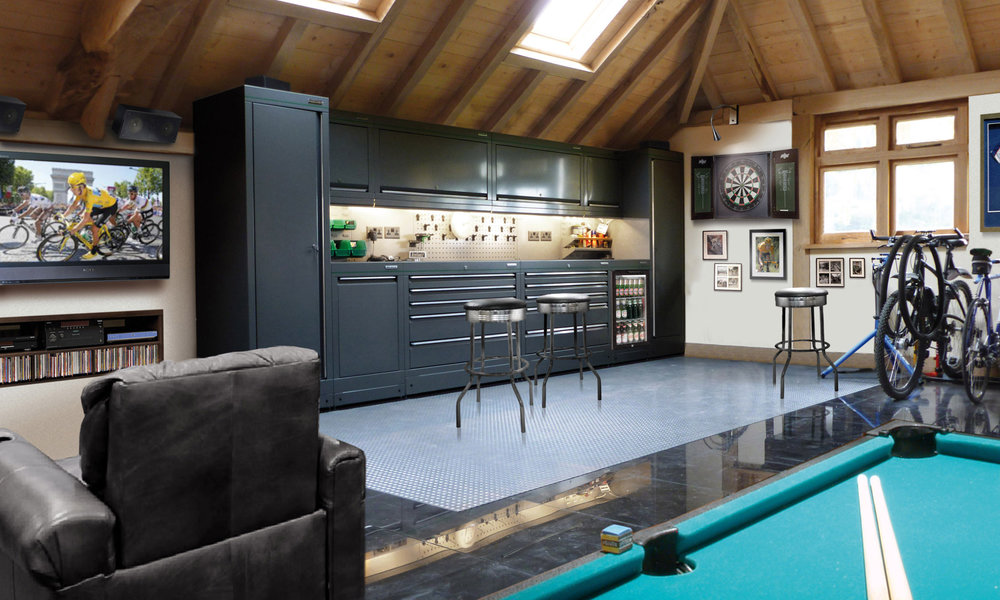 Well designed garage with lots of storage space, pool table and tv