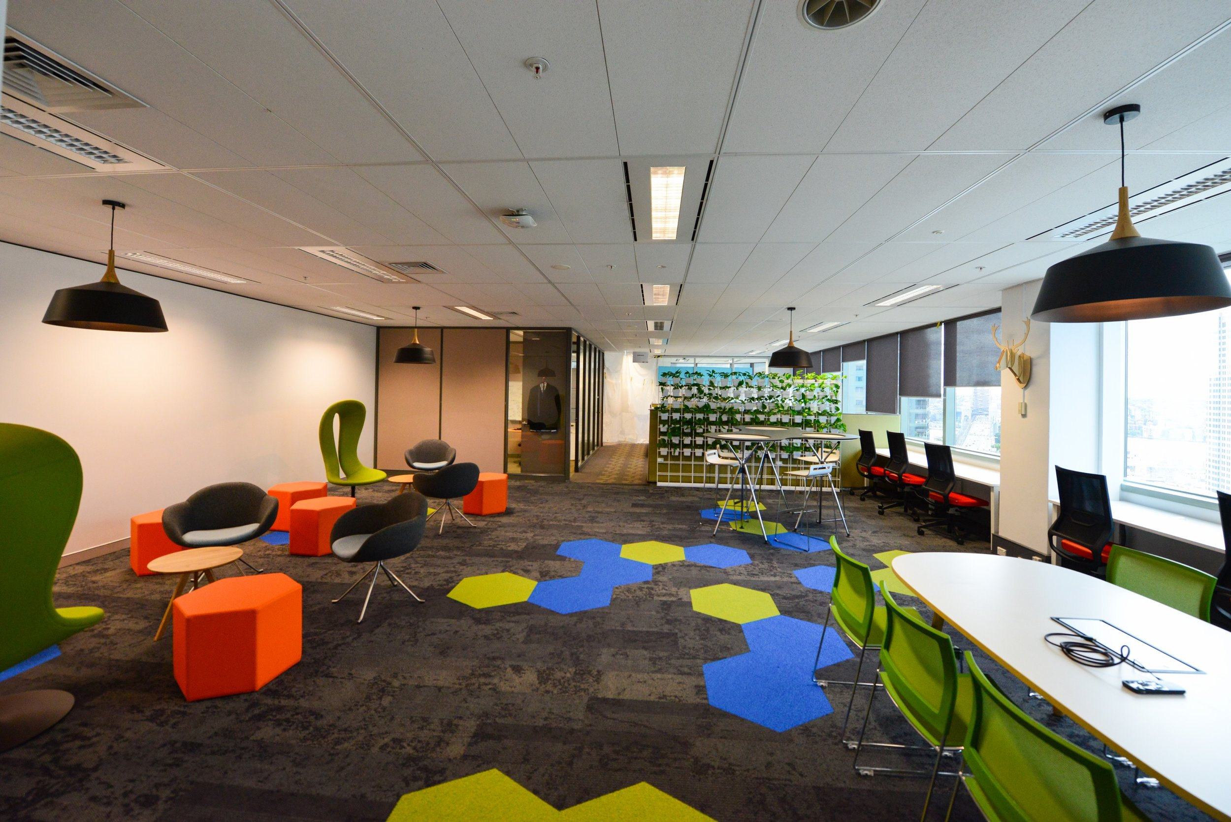 Multi-coloured carpet with matching seats of different shapes and sizes