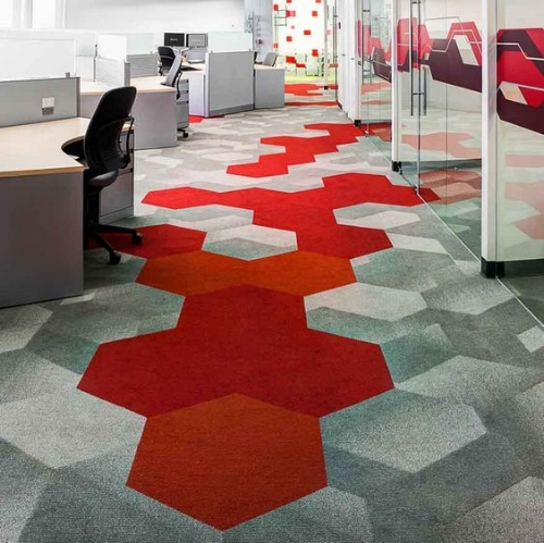 Bold carpet tiles can also act as a great way finding technique.