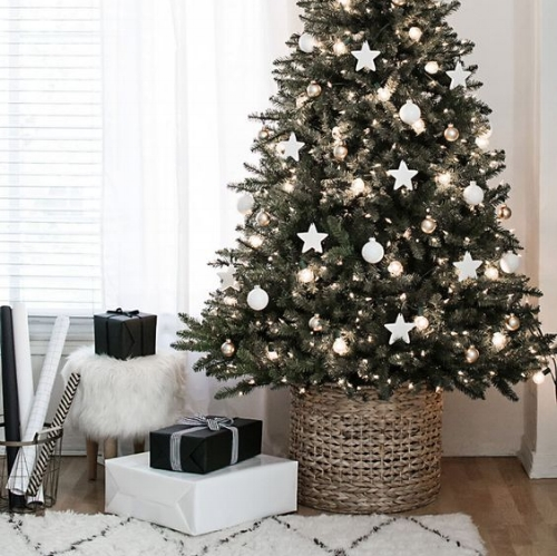 Scandi Christmas tree surrounded by presents