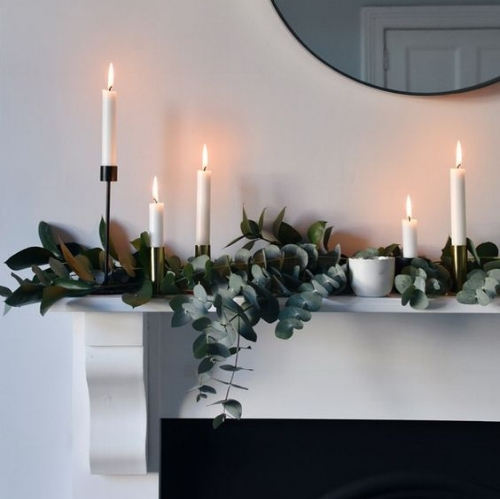 Simple and Classy - the simplicity of this mantel piece makes it a winner, investing in some beautiful candle holders makes all the difference.