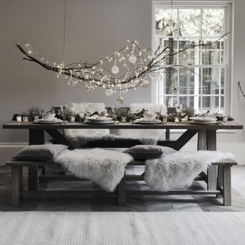 A Statement - This is such a neat idea if you are renting, suspending a branch with decorations, twinkle lights and baubles to crate big impact.