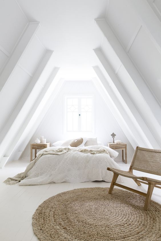 This gable ceiling could of been a disaster! but by going all white the ceiling doesn't feel as enclosing as a darker colour might of in this situation. A darker colour with a white back wall would of emphasised the narrowness at the top of the apex making it feel enclosed.