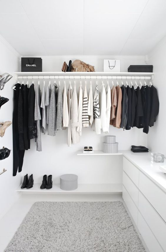 A walk in wardrobe is such a dream for many home owners. This all white walk in maximises space visually buy using fittings and fixtures the same colours as the walls and ceilings to make everything blend into one another as much as possible - less visual blocks = less visual clutter.