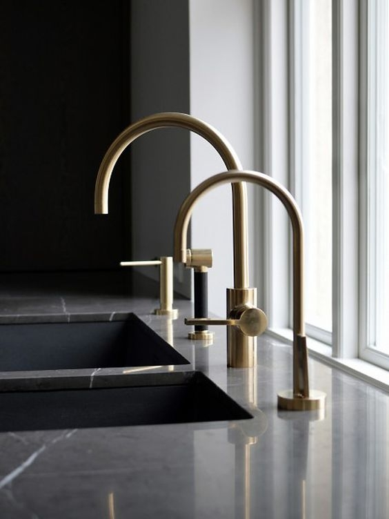 These brass taps are a beautiful design, against the black marble they make for a real statement.