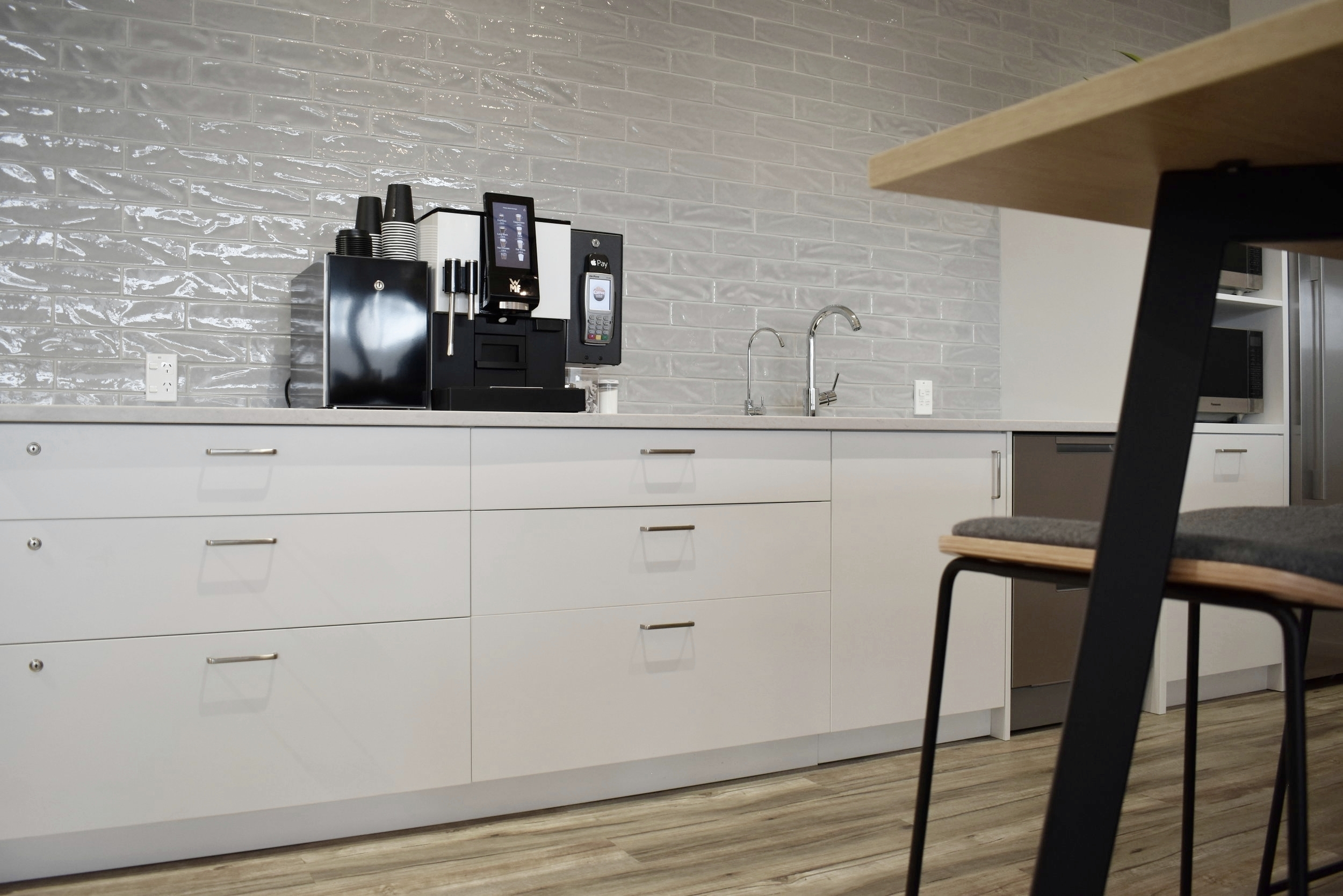 The tile splash back provides texture and movement, a lovely alternative to a piece of art work in a kitchen space.