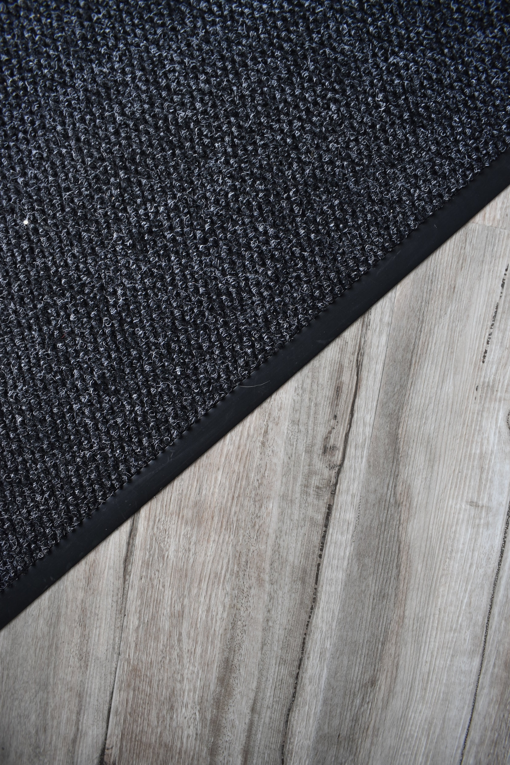 We installed a new beautiful charcoal safety matting at the entrances that sit flush with the wood plank vinyl. This gives a much tidier appearance than a loose matting which can be a trip hazard.