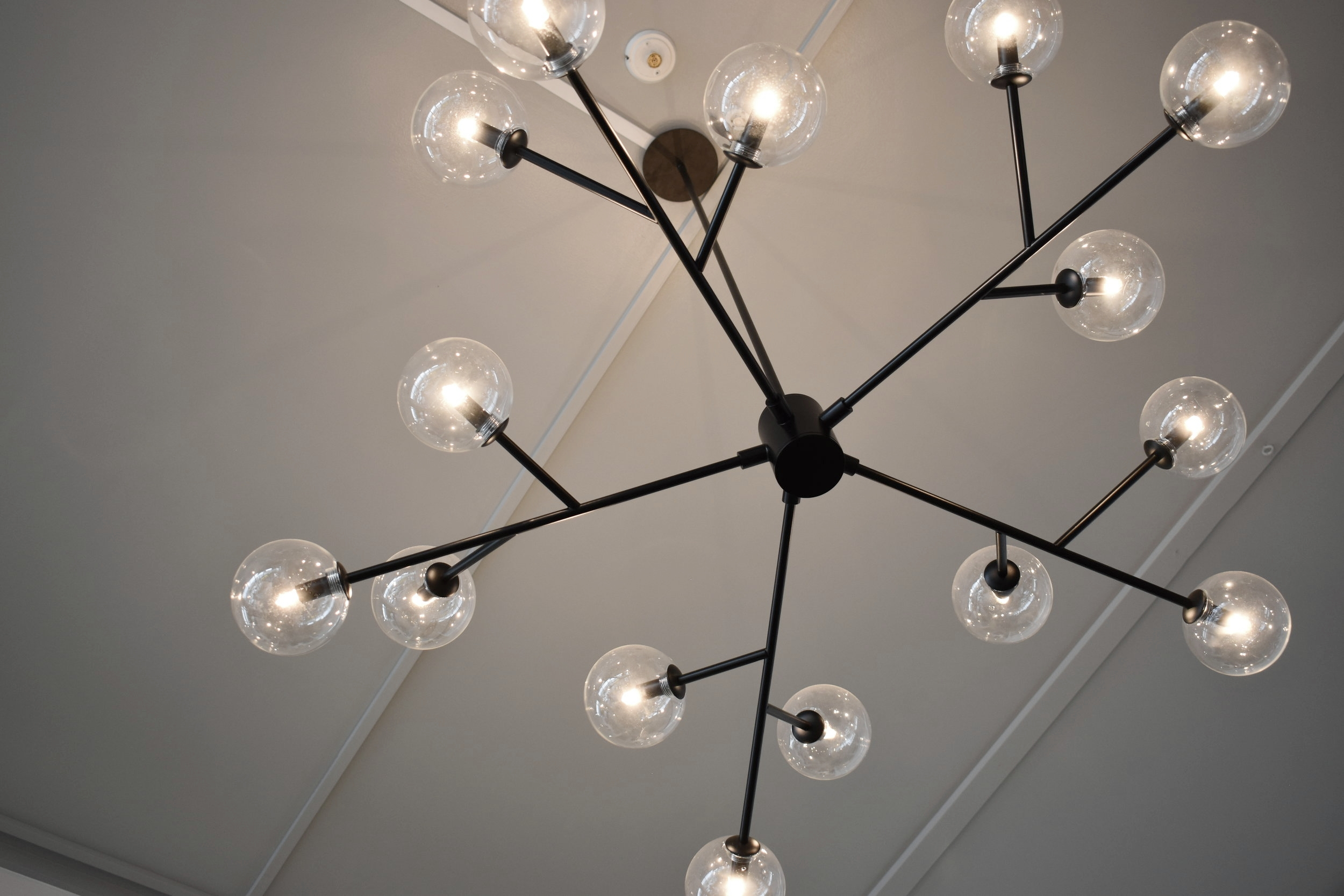 We painted the ceiling in the communal lounge area grey to make the lighting pop and define the space.
