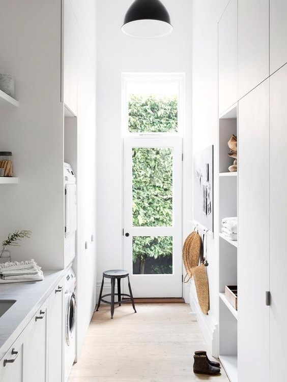 I love this family laundry because they have utilised the high ceilings for extra storage. Even when some cupboards are only accessible by standing on a step ladder, they are still worth while! They are perfect for things you don't need access frequently such as Christmas decorations and suitcases etc.