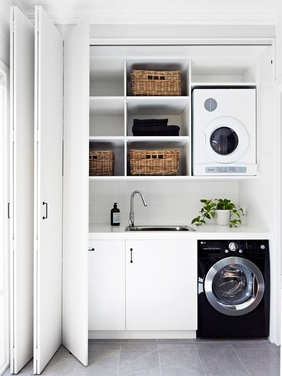 This is such a well organised, compact laundry! The bifold doors make the space easy to use and reach everything when open, and when they are closed the laundry completely disappears. I love that they have utilised every inch up to the ceiling and have maximum storage in such a small space.