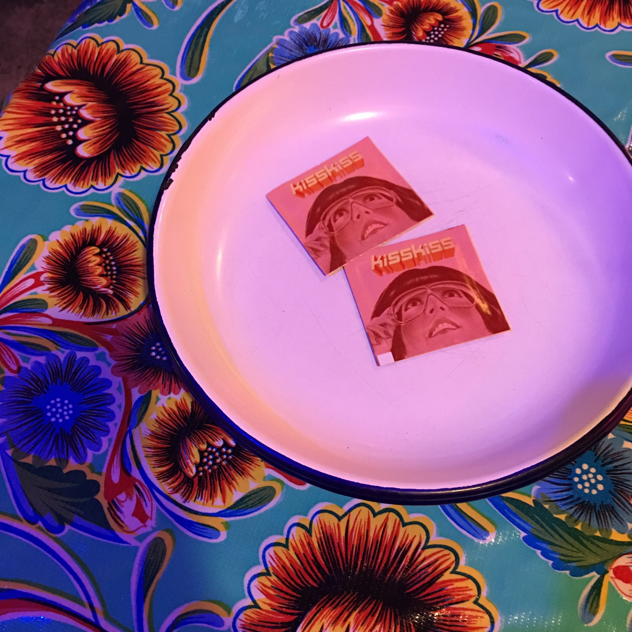Kiss Kiss hand towelettes on enamel plate.