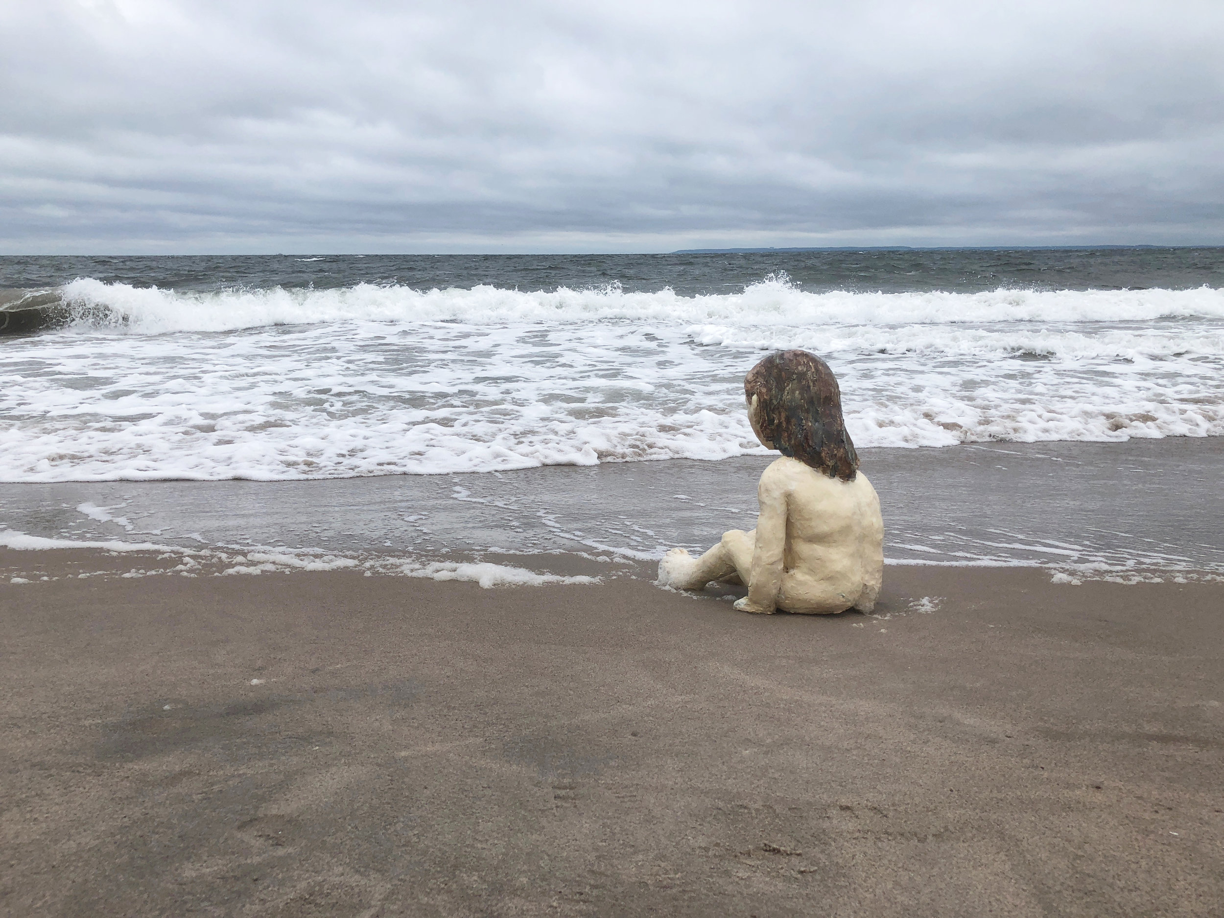 "Image: ""Girl Sitting"" as featured in ""Wading,"" a video installation; both by Claudia Alvarez"