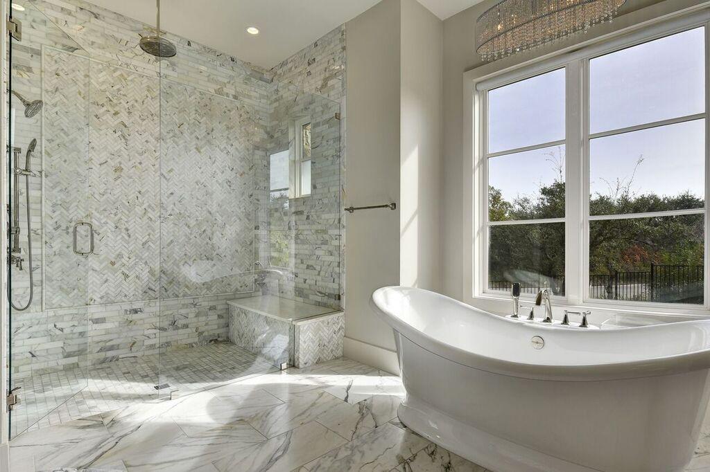 Bathroom Design with Carrara Marble Flooring and Shower